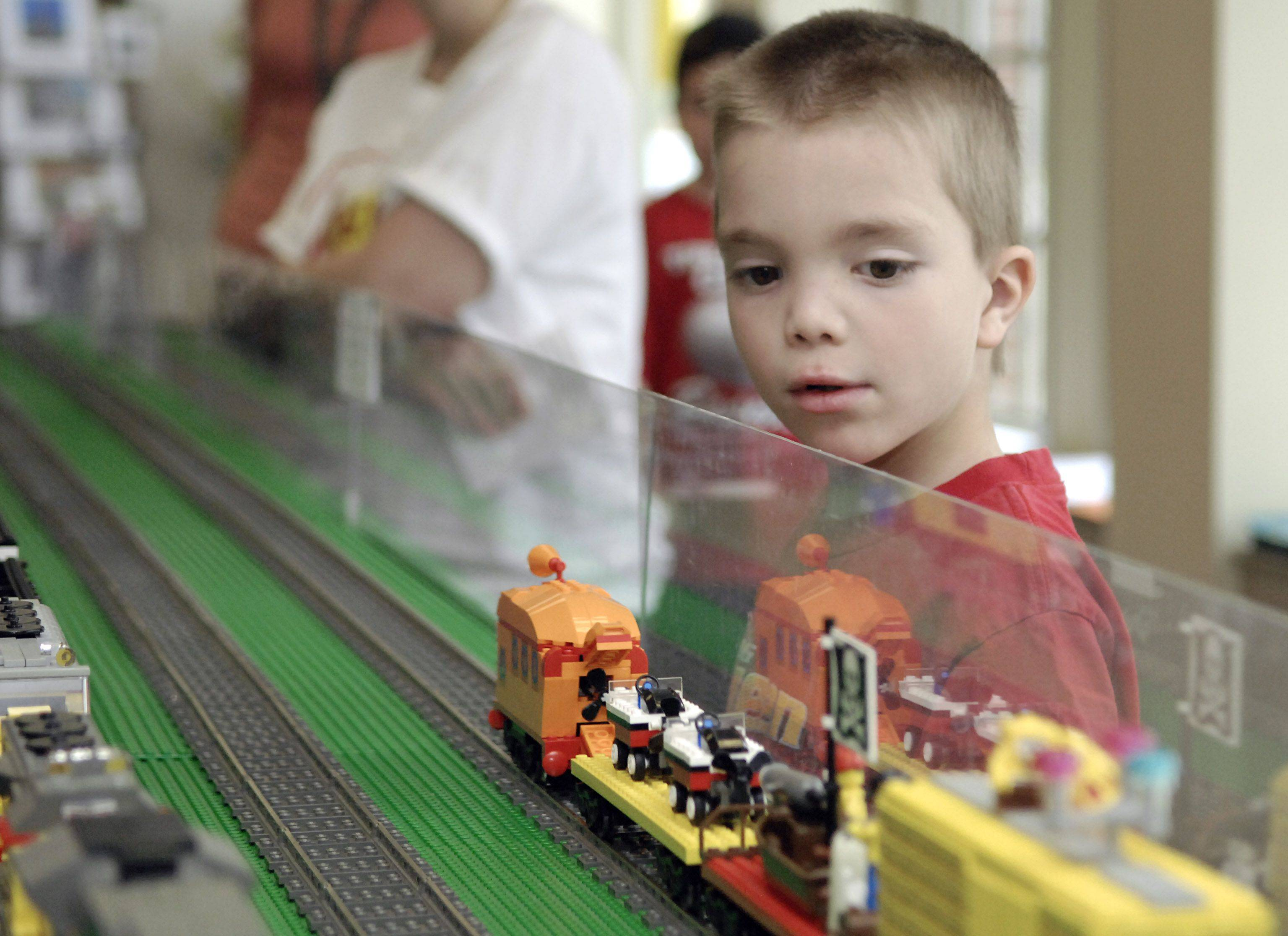 Luke Schafer, 7, of Batavia watches an operating Lego train go by at a previous year's Lego event at the Geneva History Center. This year's Lego Train Club event takes place Saturday and Sunday.