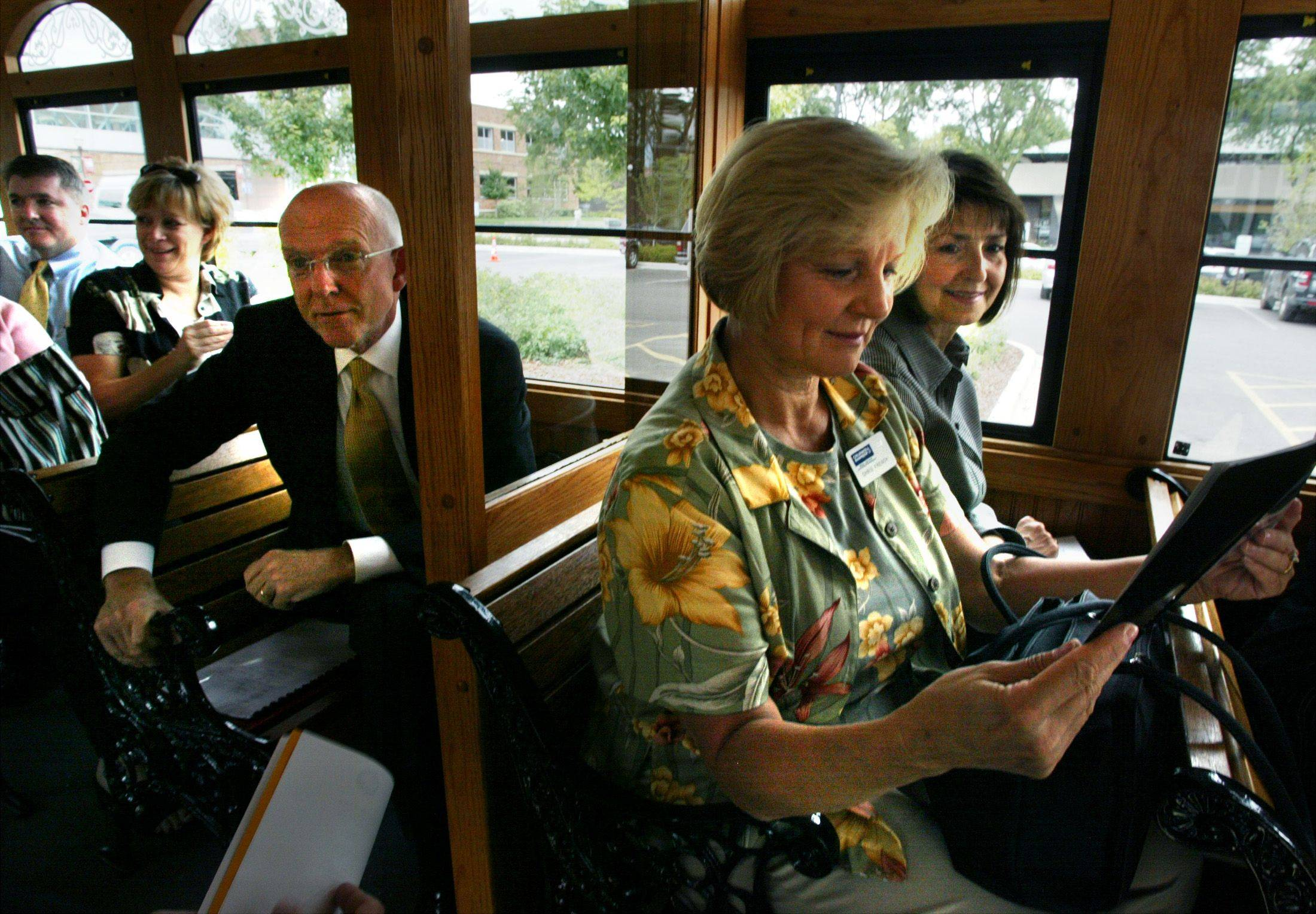 Mayor Ed Schock takes a trolley tour of Elgin with many out-of-town Realtors, including Chrish French from Schaumburg, front, and Linda Mahaney of St Charles, in 2004