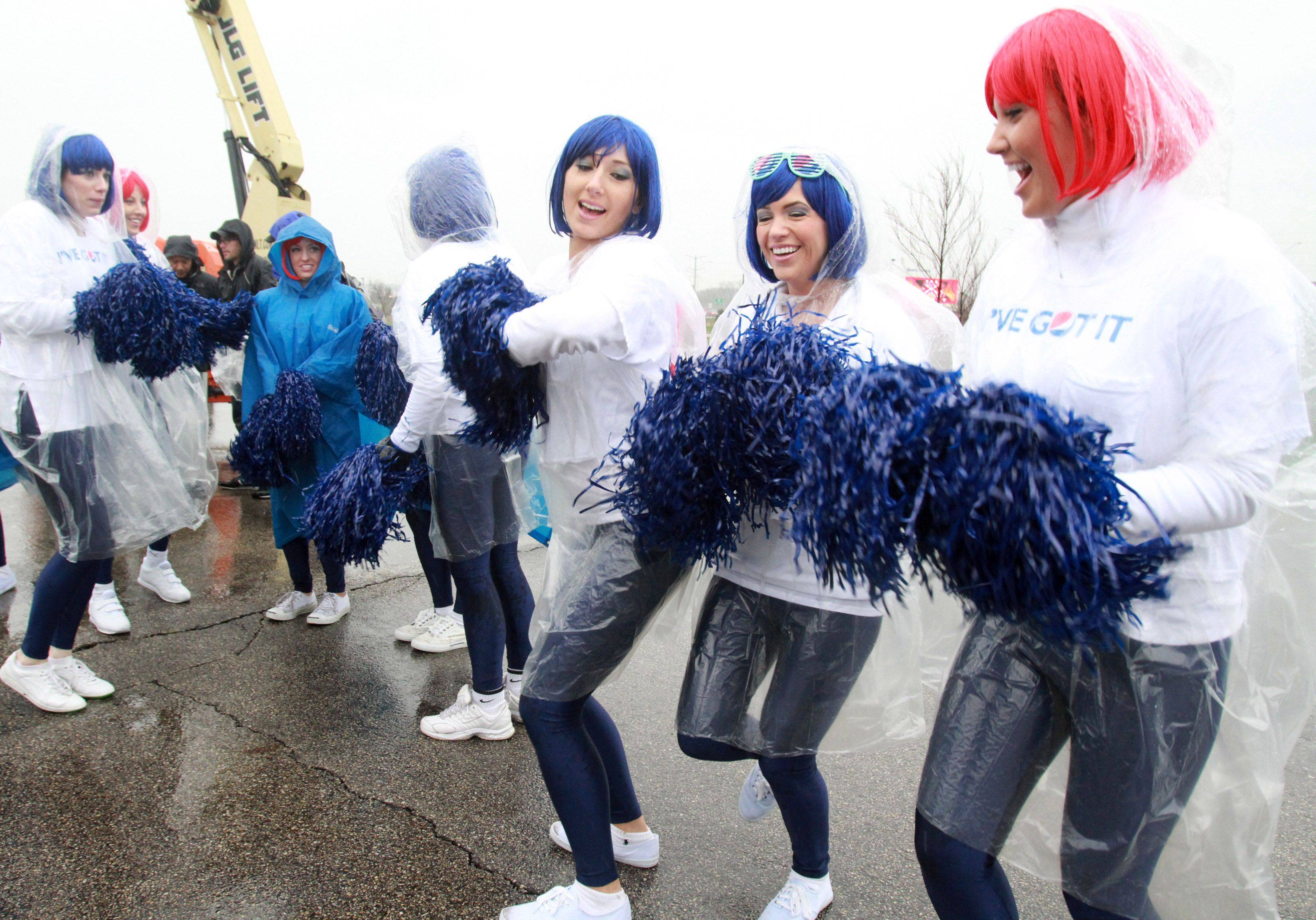 "Pepsi cheerleaders sing for thousands of suburban hopefuls who turned out in the rain to audition for Simon Cowell's new show, ""The X Factor"" at the Sears Centre in Hoffman Estates on Wednesday."