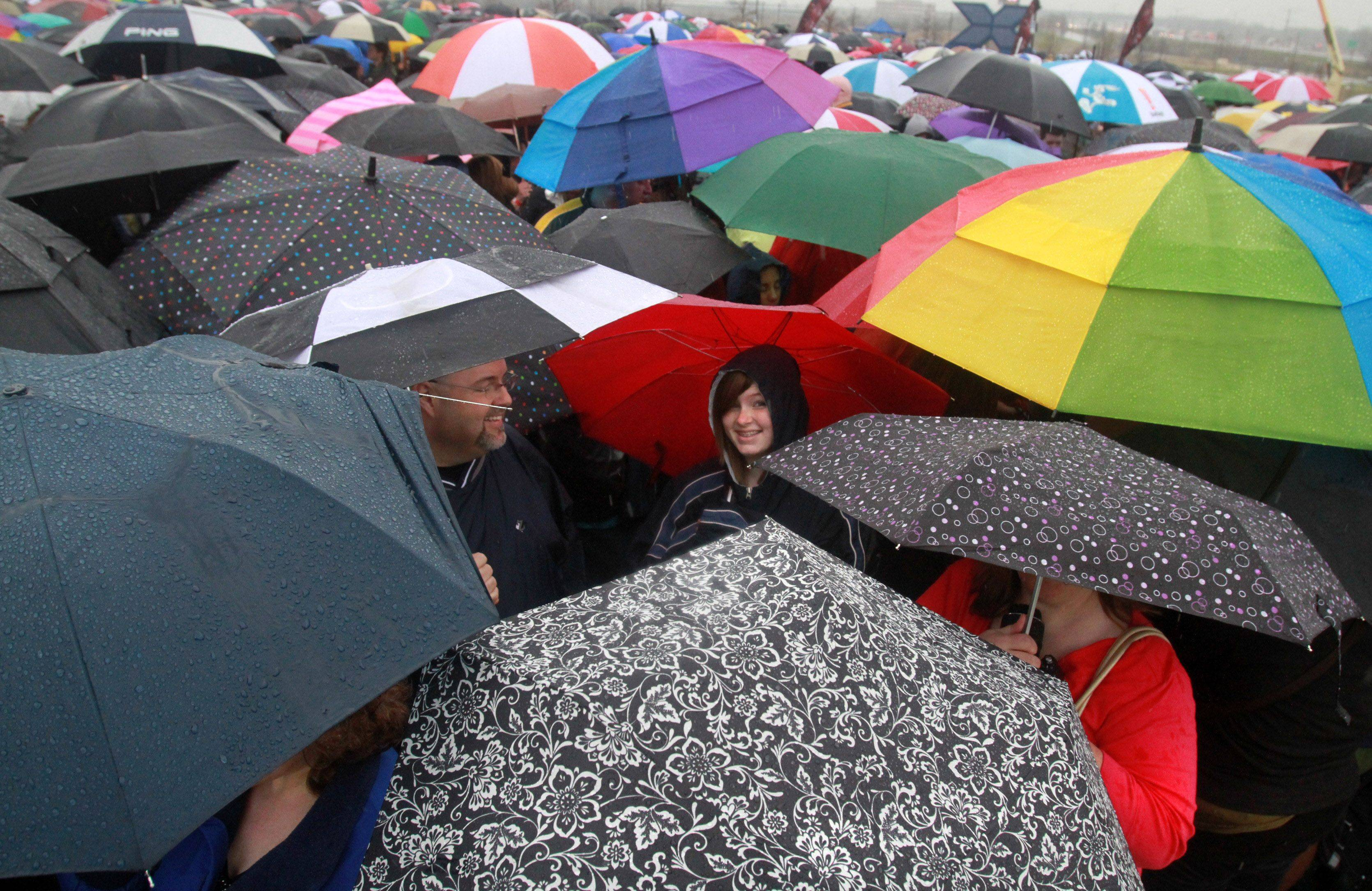 "Thousands of suburban hopefuls turned out in the rain with their umbrellas for the ""The X Factor"" auditions at the Sears Centre in Hoffman Estates."