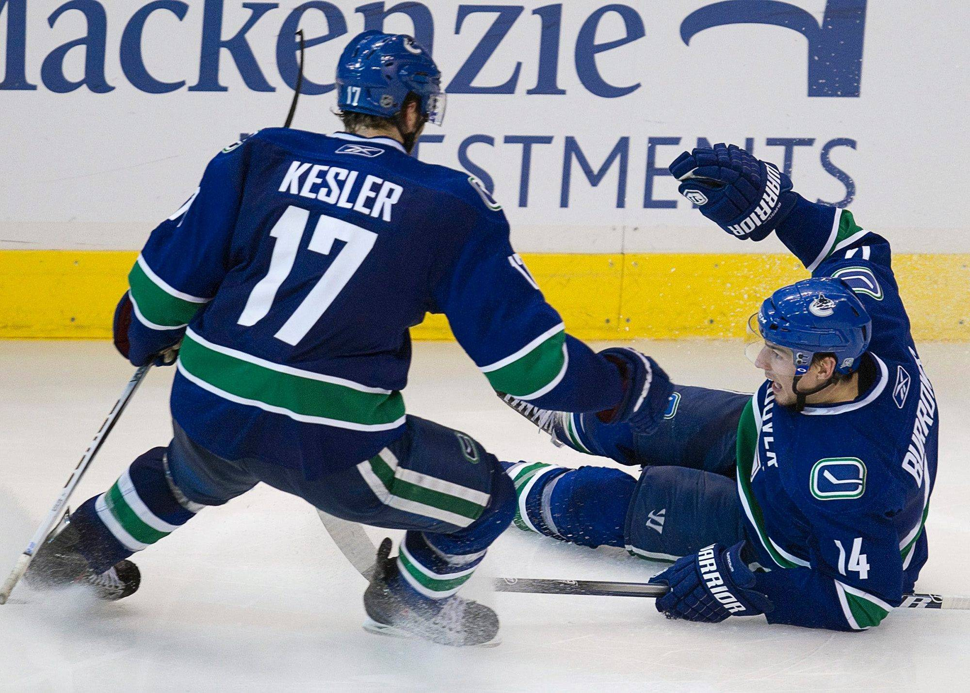 The Canucks' Alex Burrows, right, celebrates his game-winning overtime goal with Ryan Kesler on Tuesday in Game 7 of the quarterfinal series against the Blackhawks.