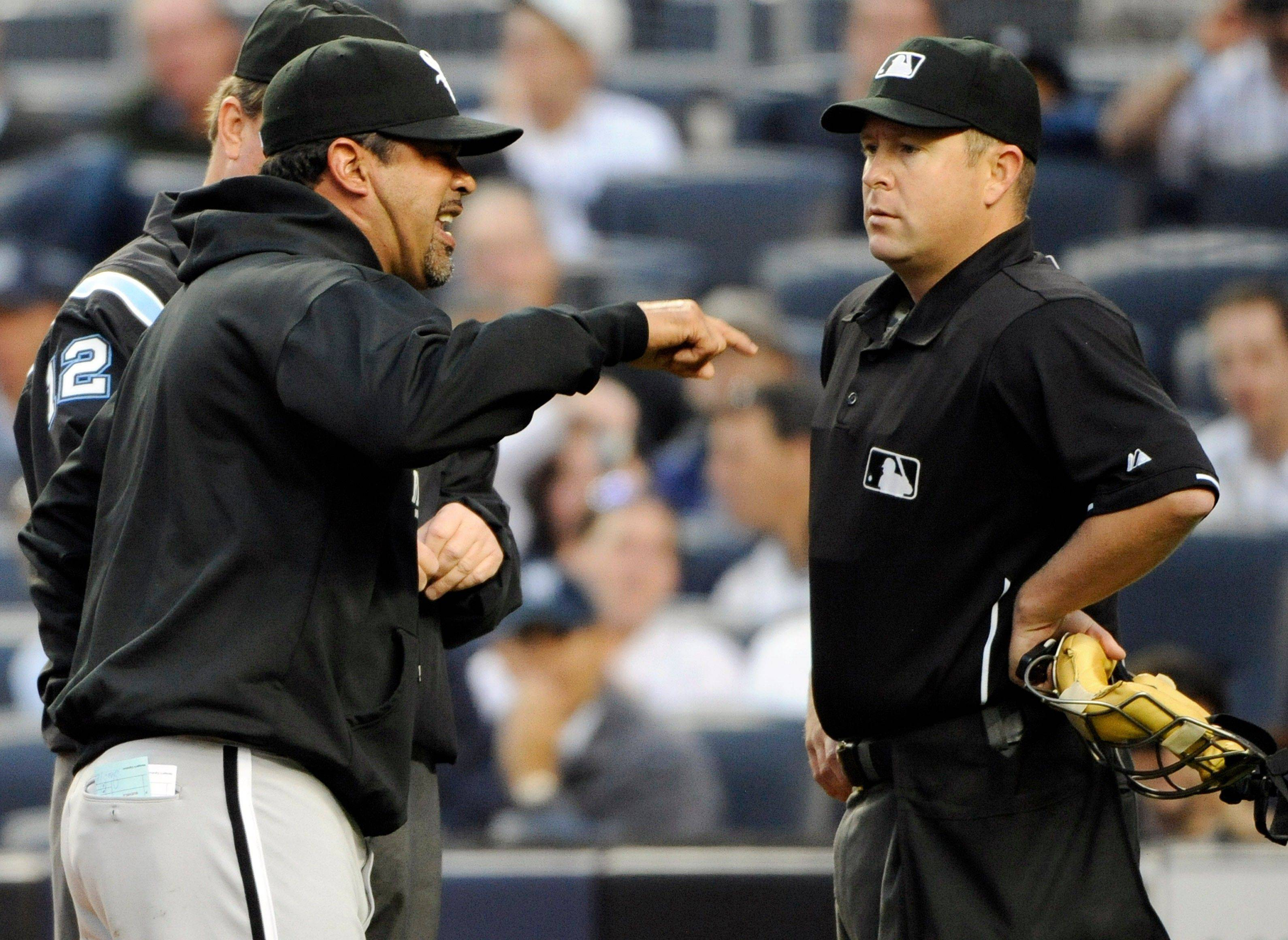 Chicago White Sox mamager Ozzie Guillen, left, argues with home plate umpire Todd Tichenor during the first inning of a baseball game against the New York Yankees, Wednesday, April 27, 2011, at Yankee Stadium in New York.