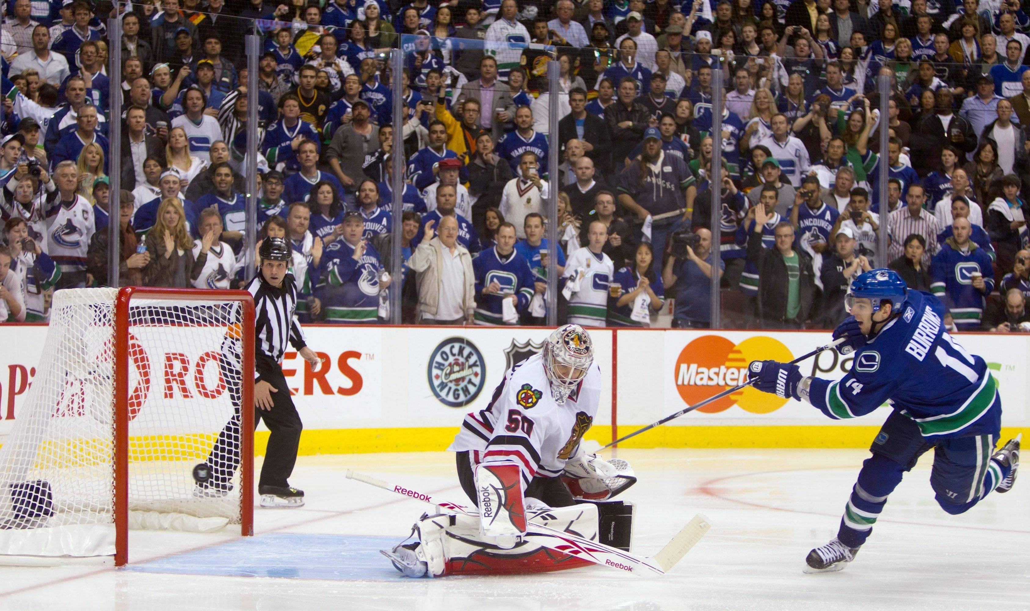Vancouver Canucks' Alex Burrows is stopped on a penalty shot by Blackhawks goalie Corey Crawford in the third period of game 7.