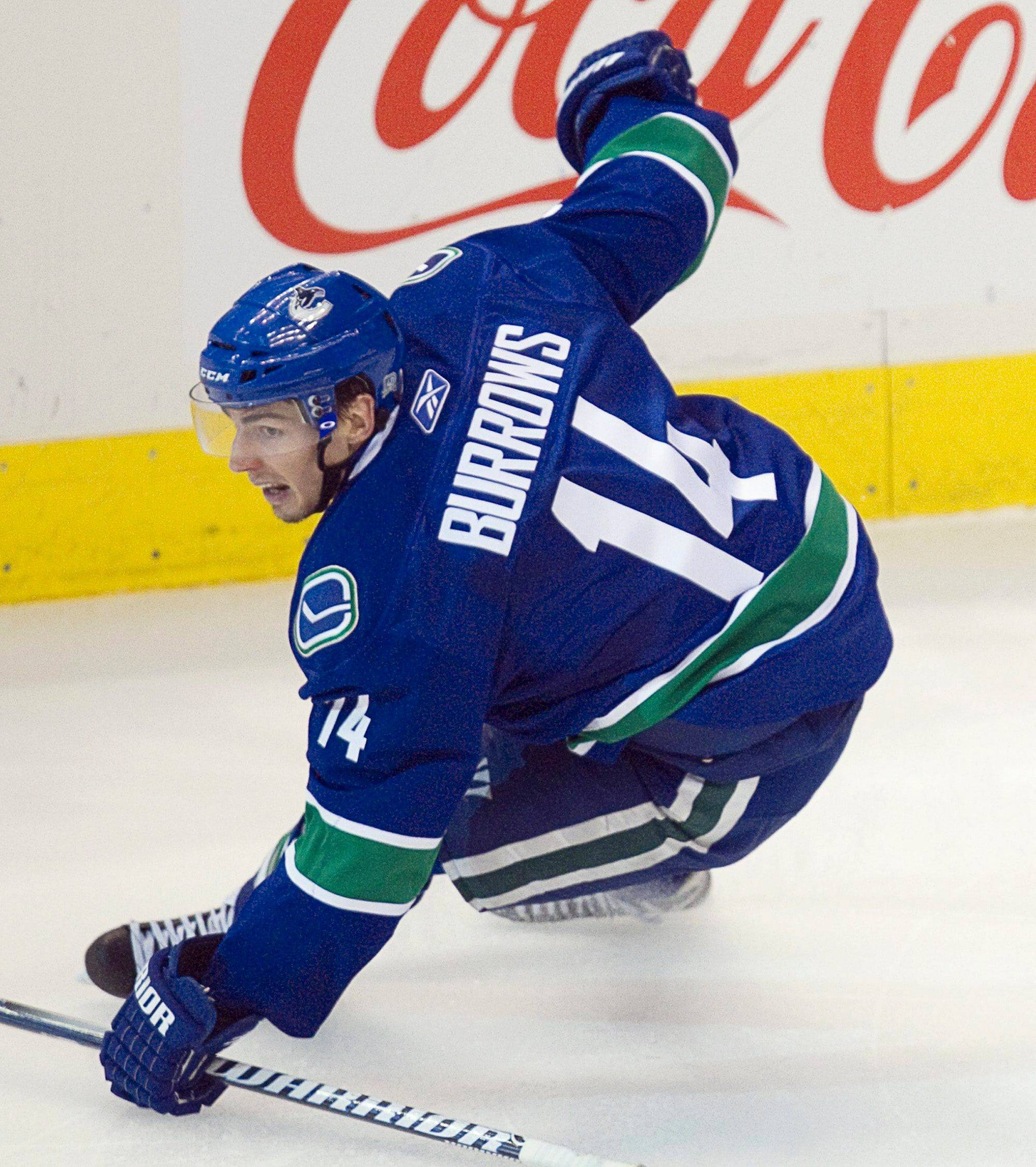 Vancouver Canucks' Alex Burrows celebrates his game winning goal against the Chicago Blackhawks during the overtime period of game 7 of an NHL Western Conference quarterfinal Stanley Cup playoff hockey series Tuesday.
