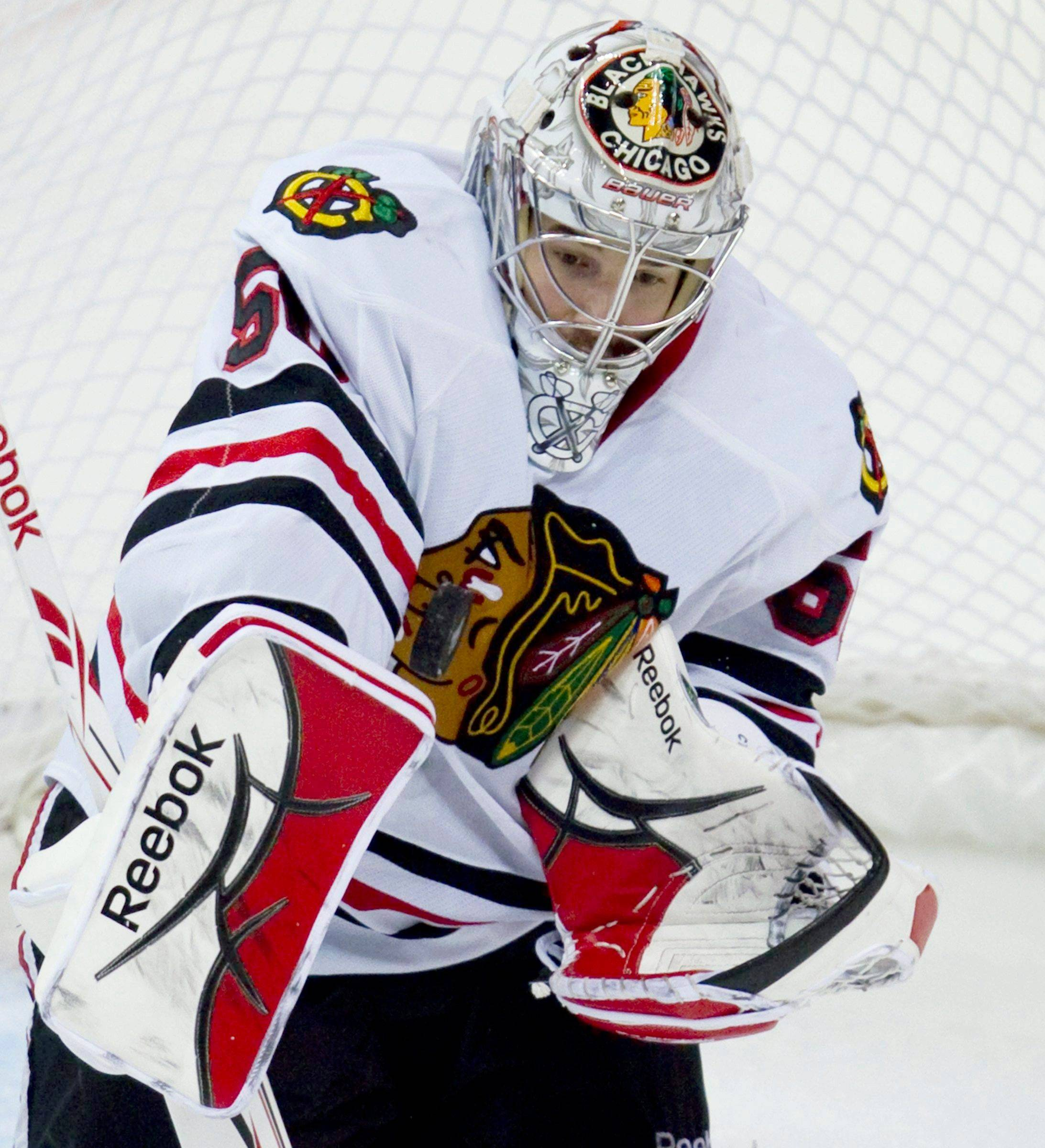 Blackhawks goalie Corey Crawford makes a save during the second period against the Vancouver Canucks in Game 7 Tuesday.