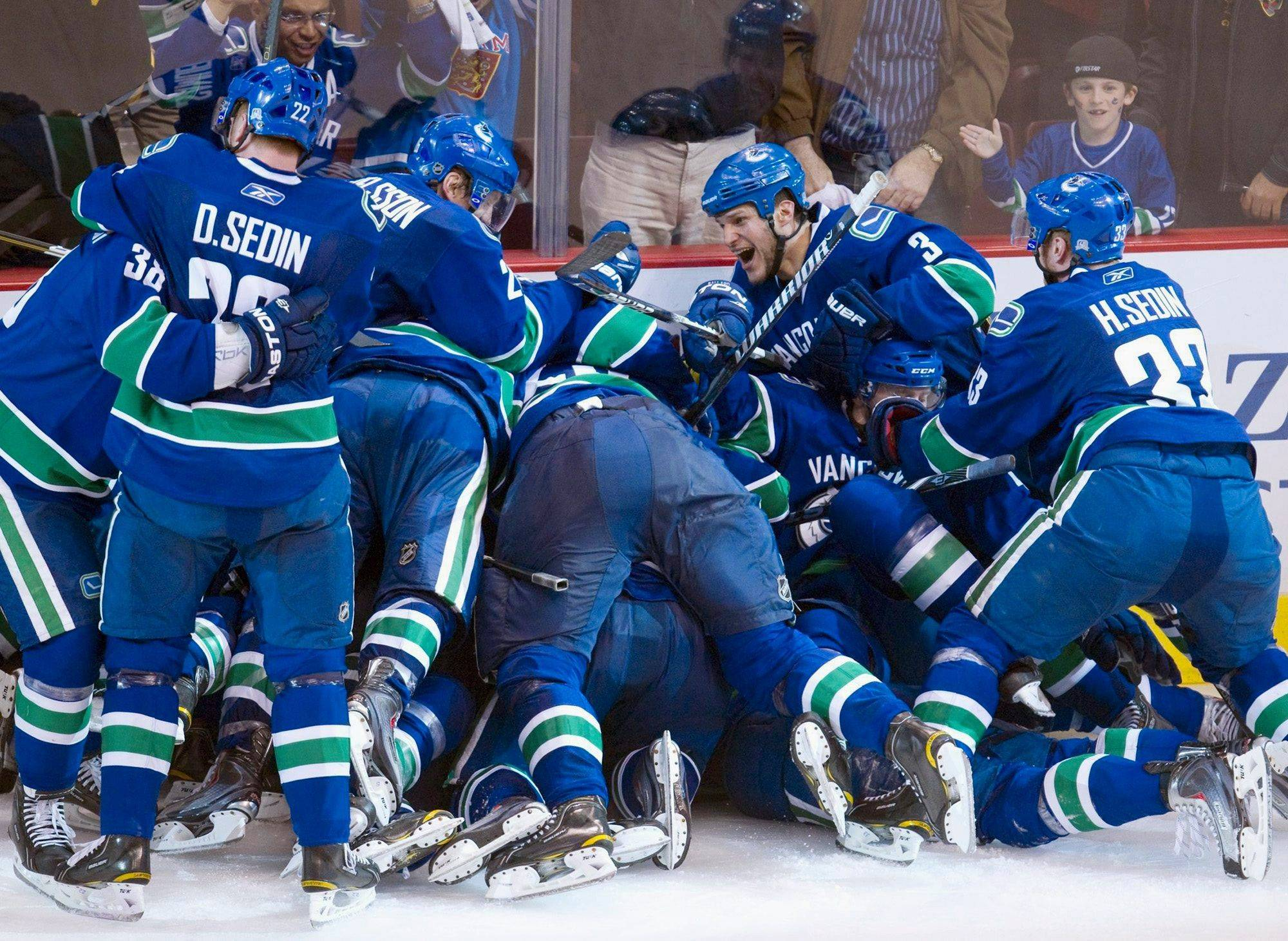 The Vancouver Canucks celebrate Alex Burrows game winning goal during the overtime period against the Chicago Blackhawks Tuesday April 26, 2011.
