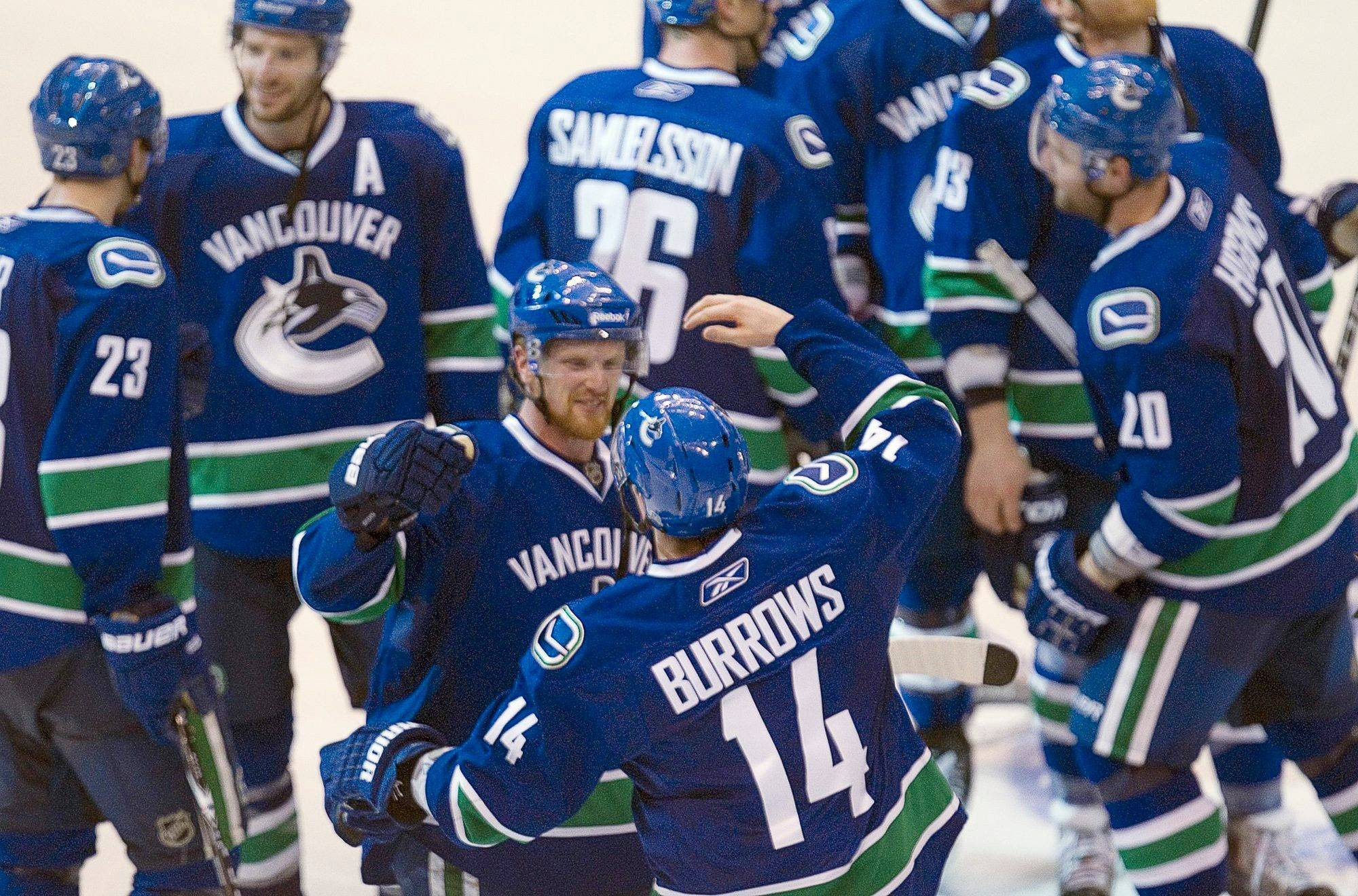 Vancouver Canucks' Alex Burrows celebrates his game winning goal with team captain Henrik Sedin against the Chicago Blackhawks in game 7 of the NHL Western Conference quarterfinal Stanley Cup playoff series Tuesday.