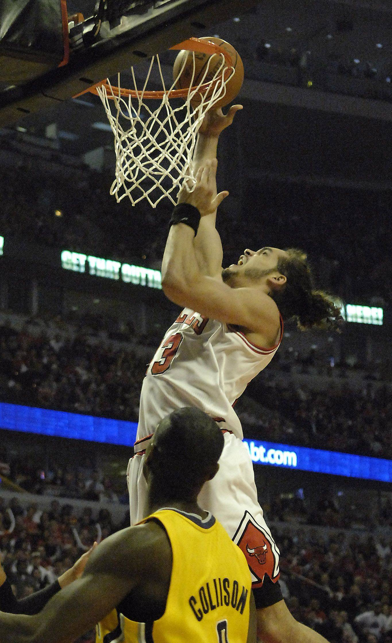 Chicago Bulls center Joakim Noah scores and is fouled during the first half of game 5 of the NBA Eastern Conference quarterfinals in Chicago Tuesday.