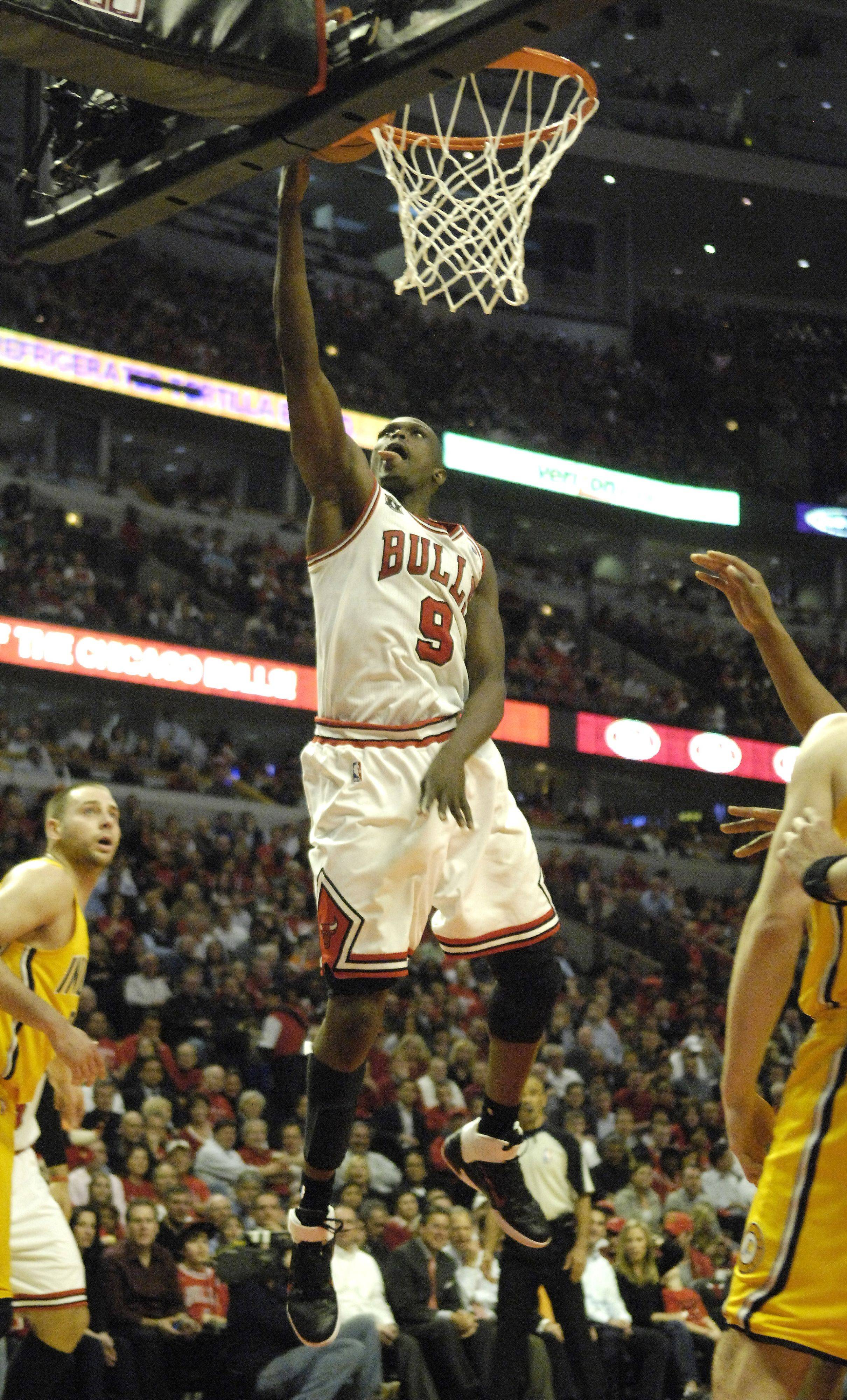 Chicago Bulls small forward Luol Deng drives and scores in an open lane Tuesday.