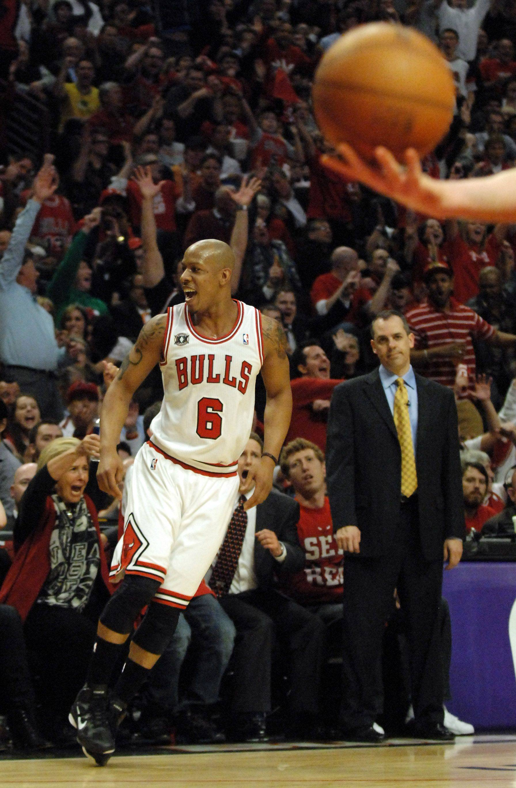 Chicago Bulls guard Keith Bogans celebrates his 5th 3-pointer in front of a chagrined Indiana Pacers head coach Frank Vogel during game 5 of the NBA Eastern Conference quarterfinals in Chicago Tuesday.