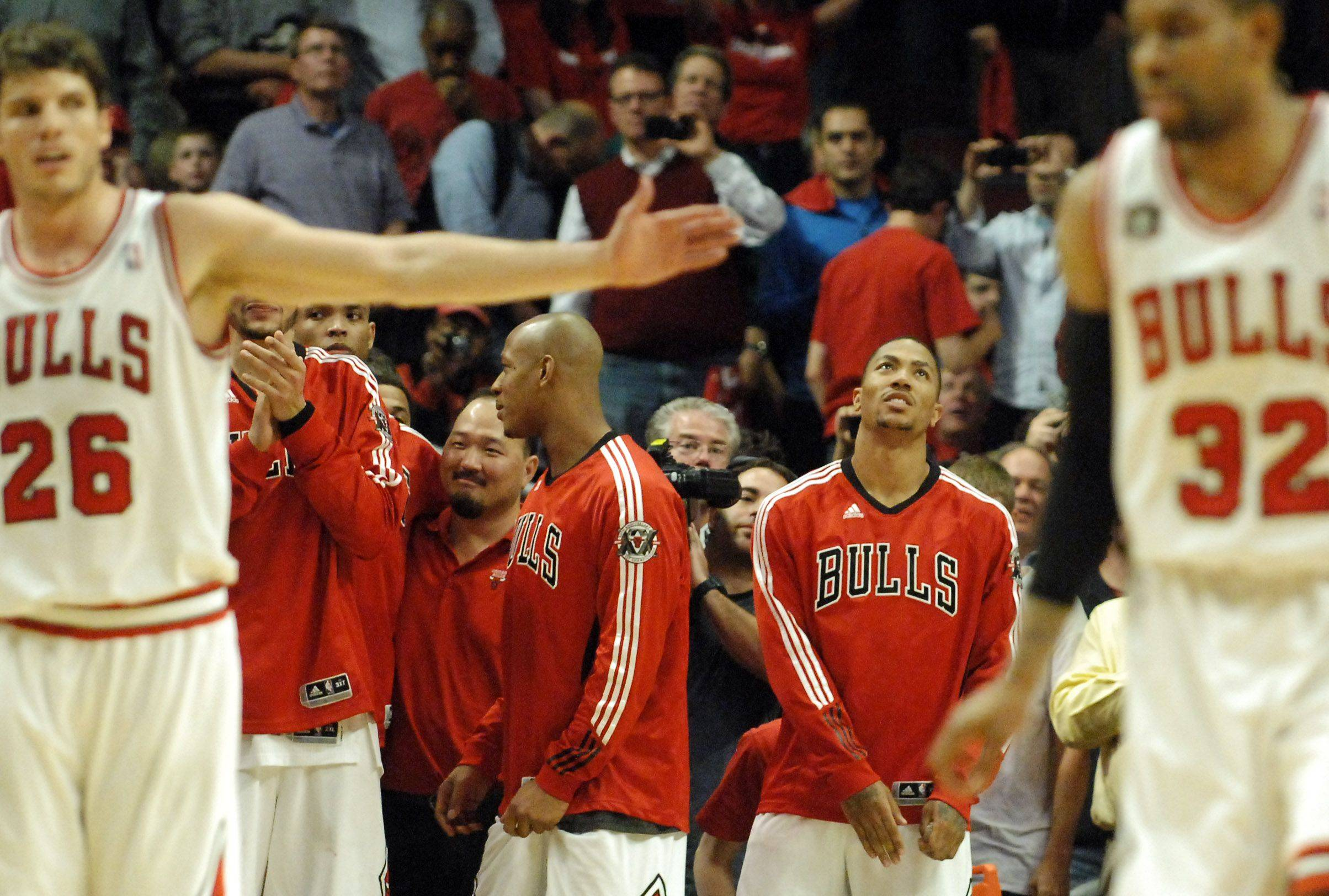 Derrick Rose watches the final seconds tick off from the bench in Chicago Tuesday.