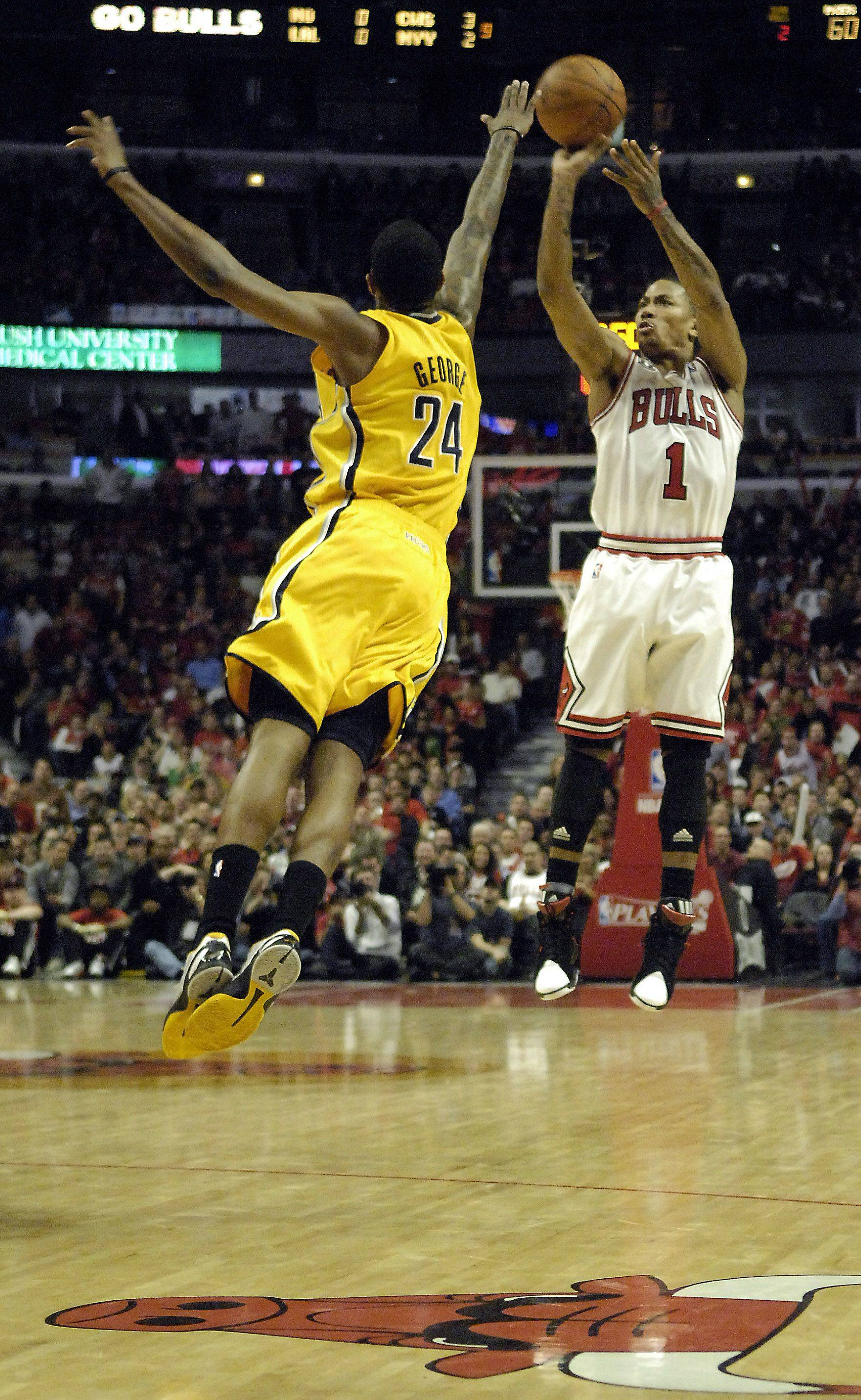 Chicago Bulls point guard Derrick Rose drains a three-pointer over Indiana Pacers small forward Paul George during game 5 of the NBA Eastern Conference quarterfinals in Chicago Tuesday.