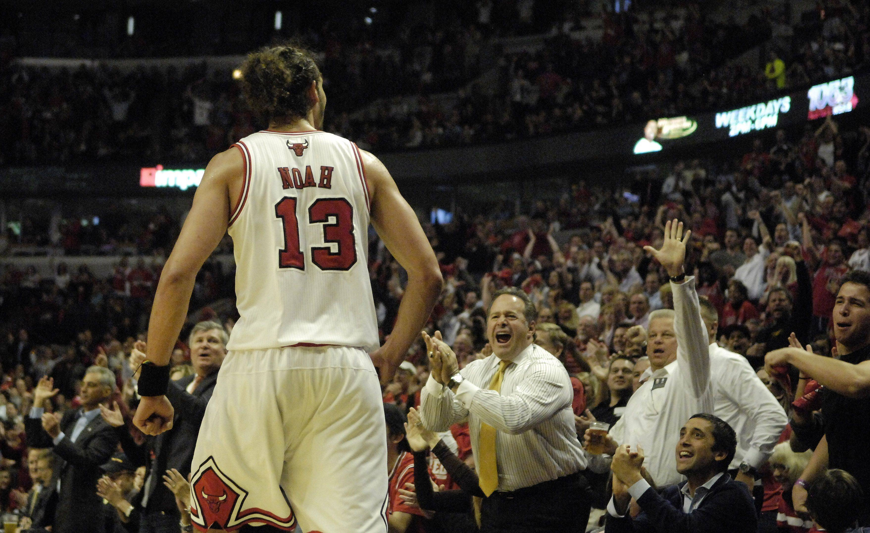 Fans cheer for Bulls center Joakim Noah in Chicago Tuesday.