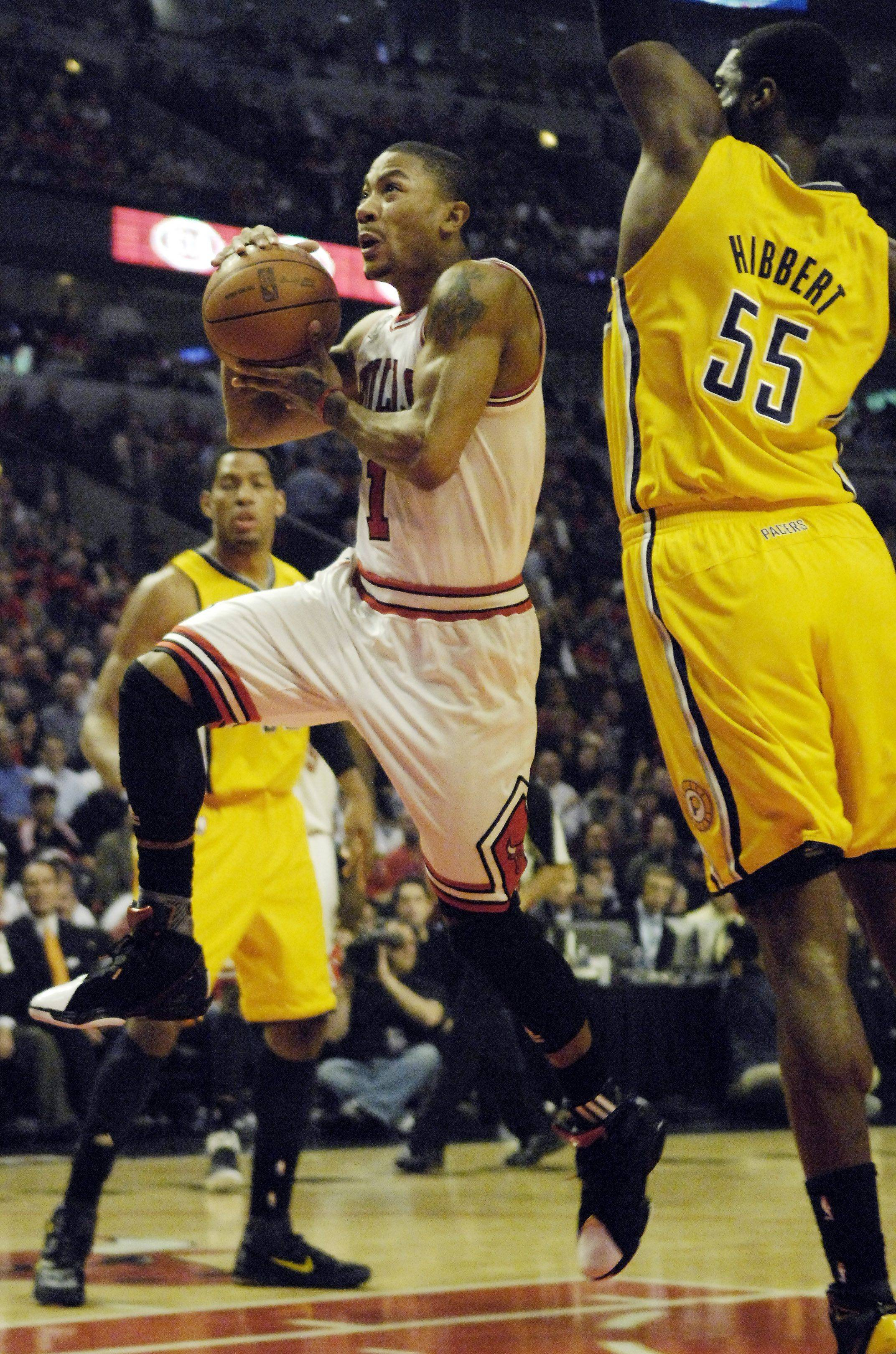 Bulls point guard Derrick Rose drives to the basket past Indiana Pacers center Roy Hibbert during game 5.