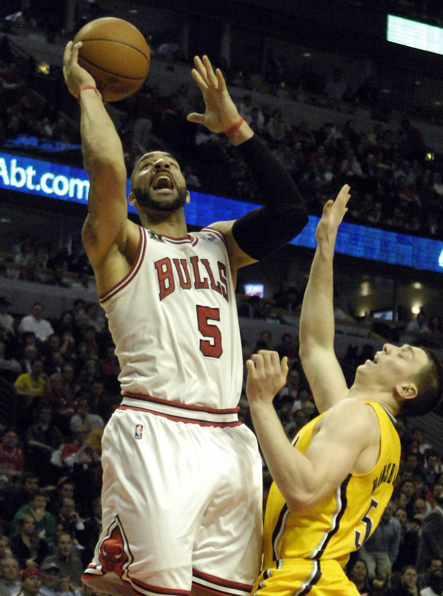 Power forward Carlos Boozer misses a shot during game 5 of the NBA Eastern Conference quarterfinals in Chicago Tuesday. He made just 1 of 5 shots.