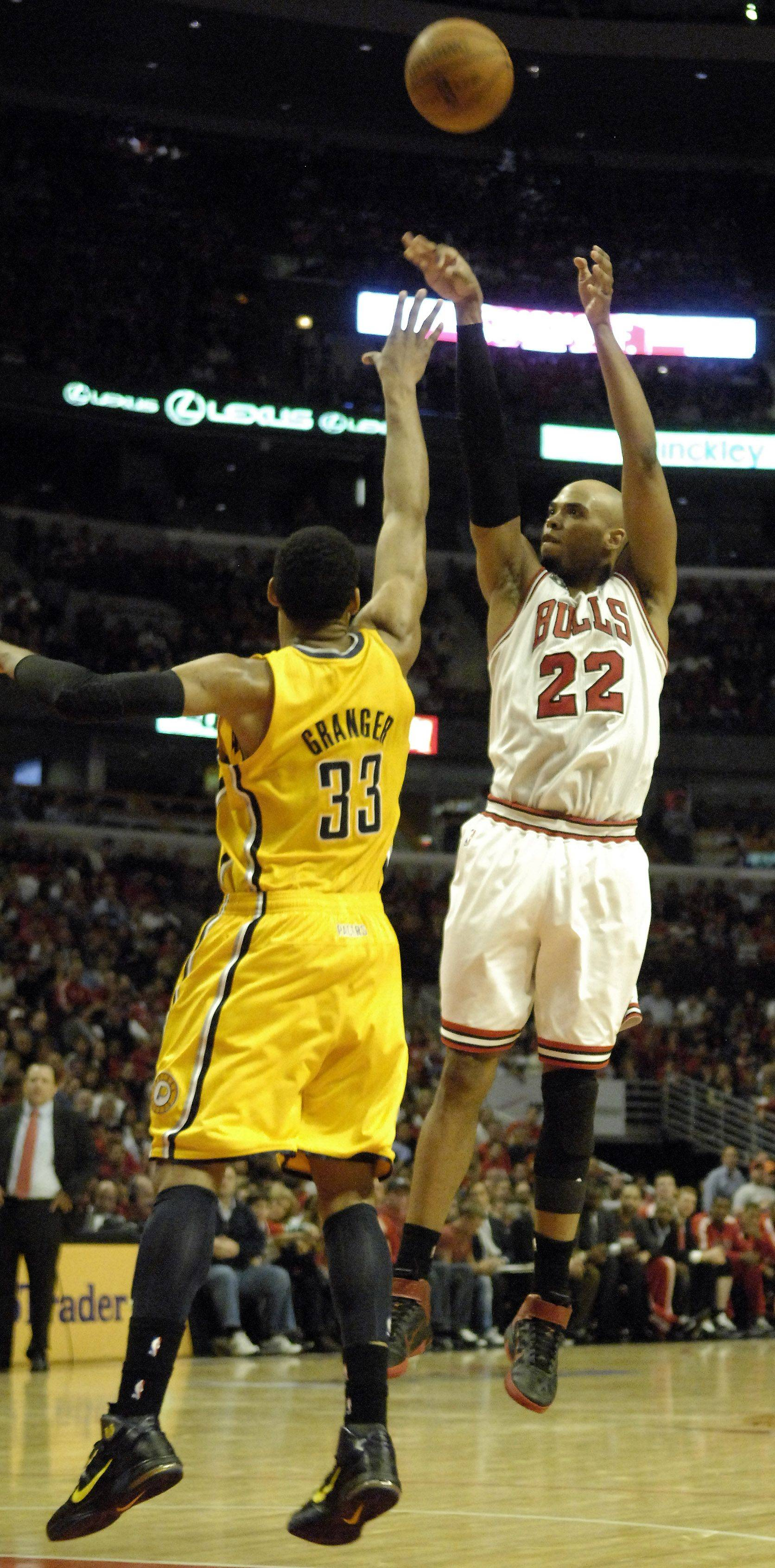 Bulls forward Taj Gibson scores a jump shot over Pacers small forward Danny Granger in Chicago Tuesday.