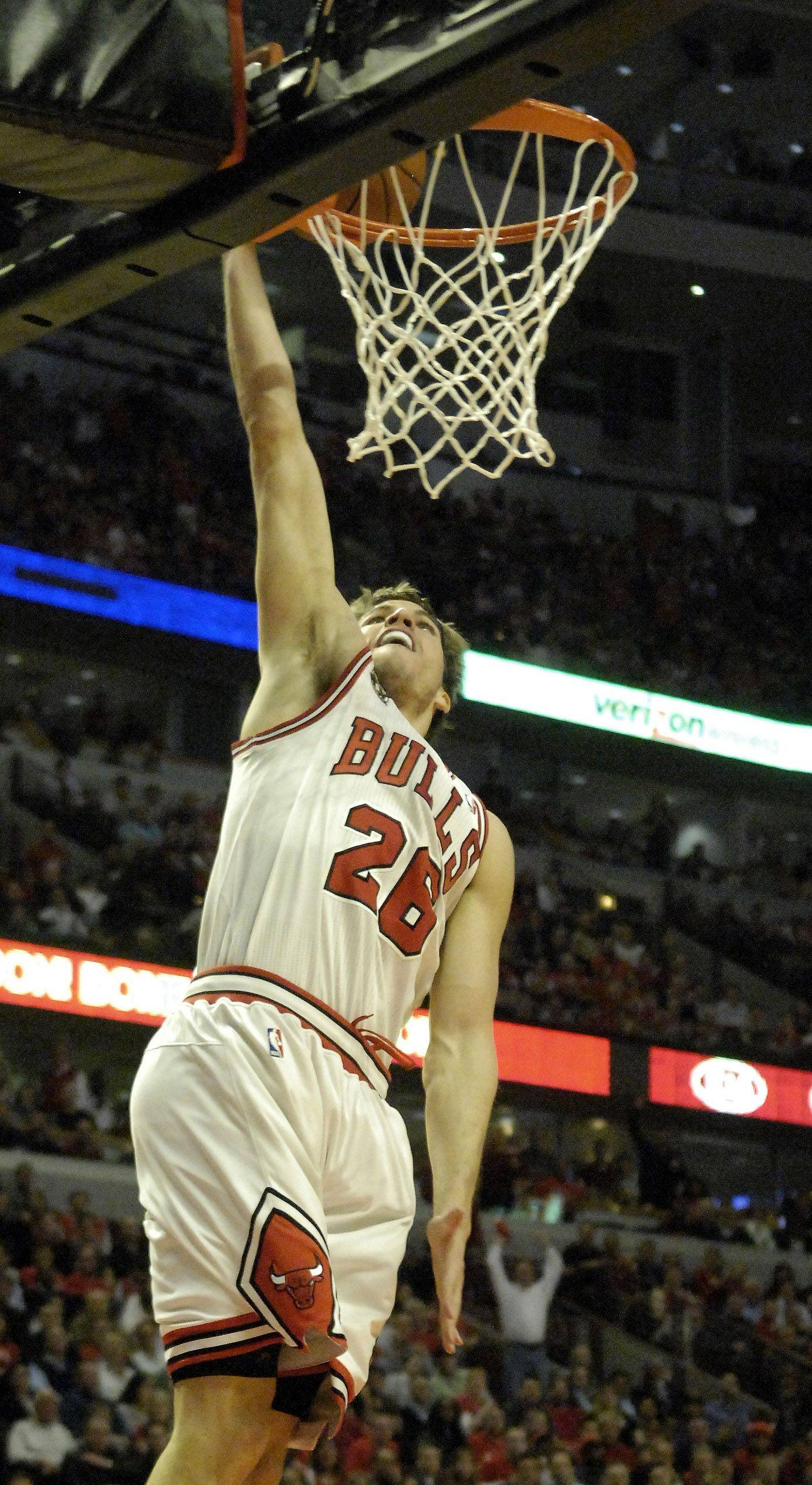 Chicago's Kyle Korver drops in an open layup during game 5 in Chicago Tuesday.