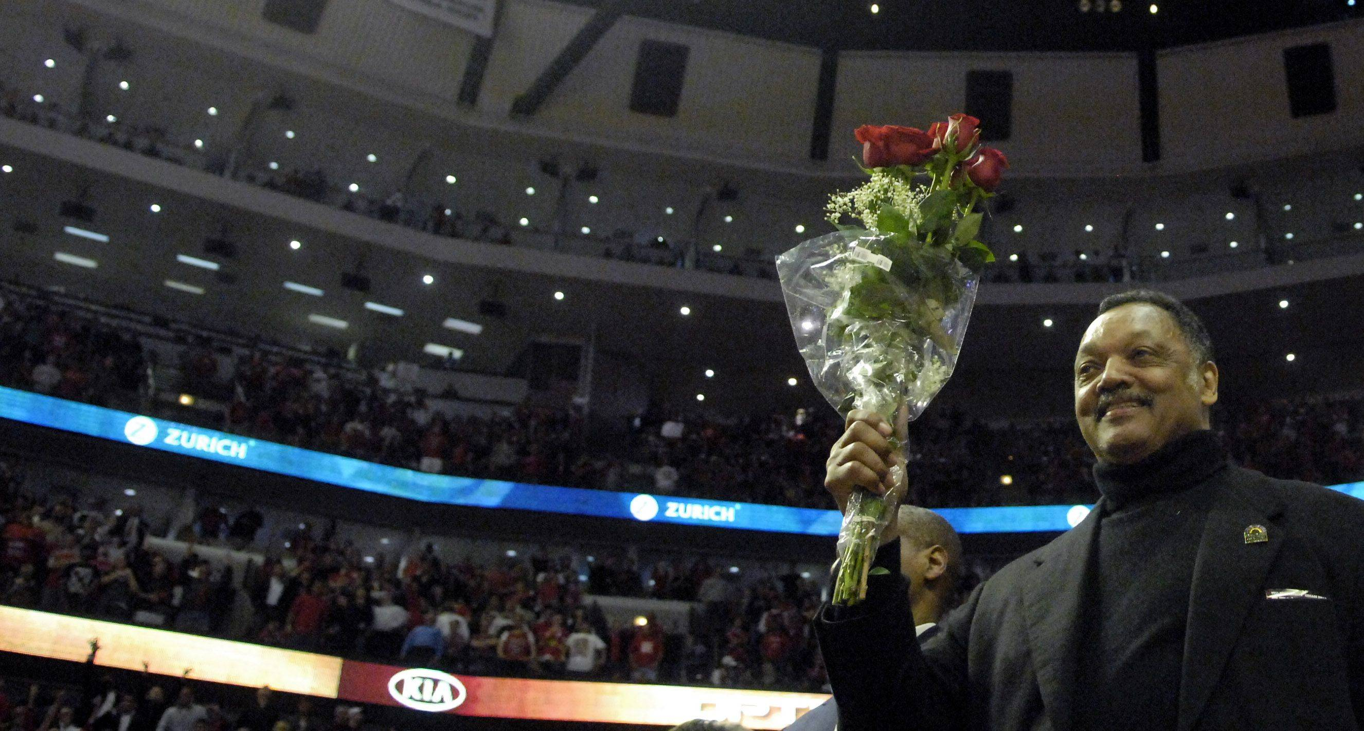 Jesse Jackson shows his love of Rose(s) during game 5 of the NBA Eastern Conference quarterfinals in Chicago Tuesday.