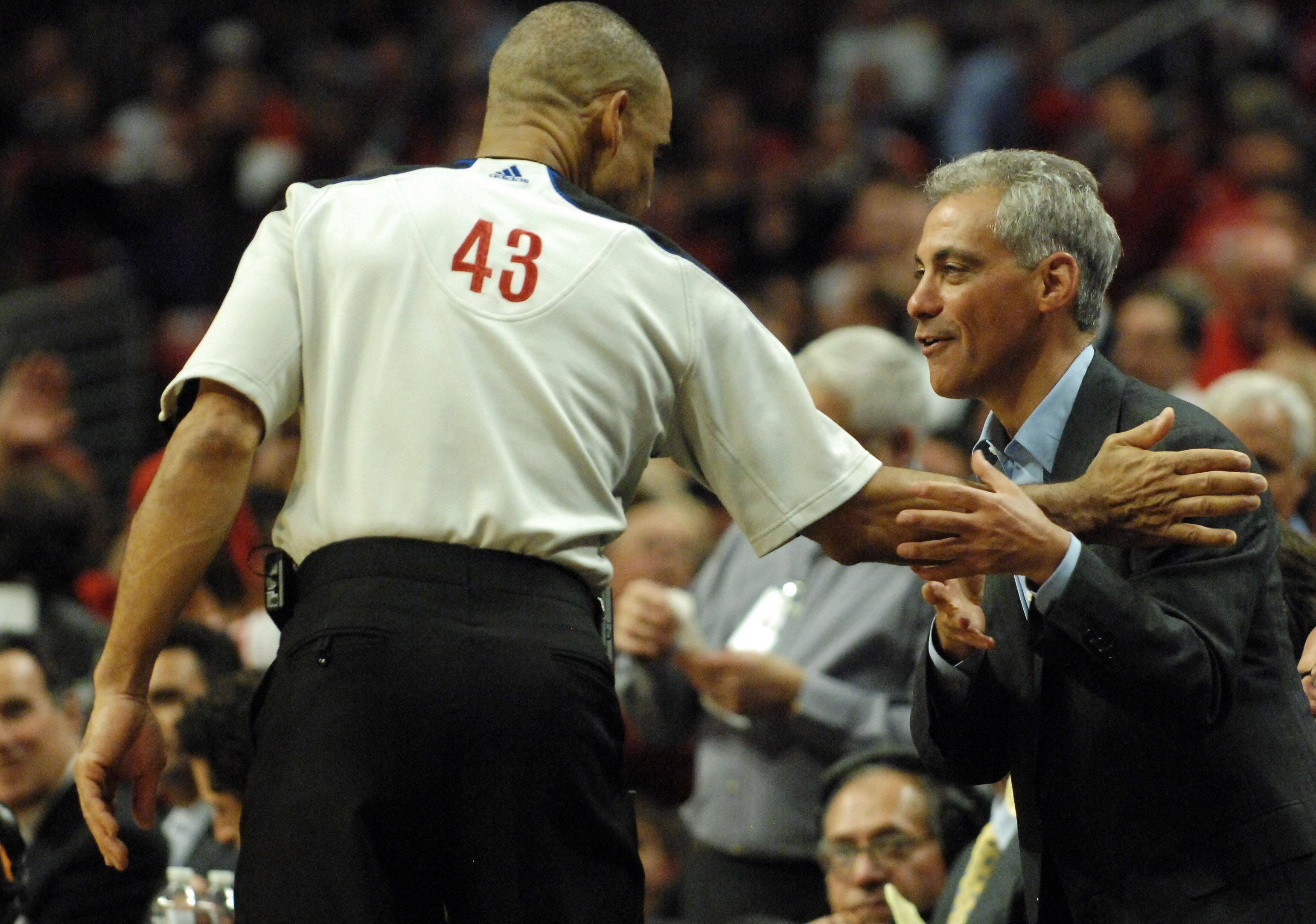 Mayor Rahm Emmanuel jokes with referee Dan Crawford during game 5 of the NBA Eastern Conference quarterfinals in Chicago Tuesday.