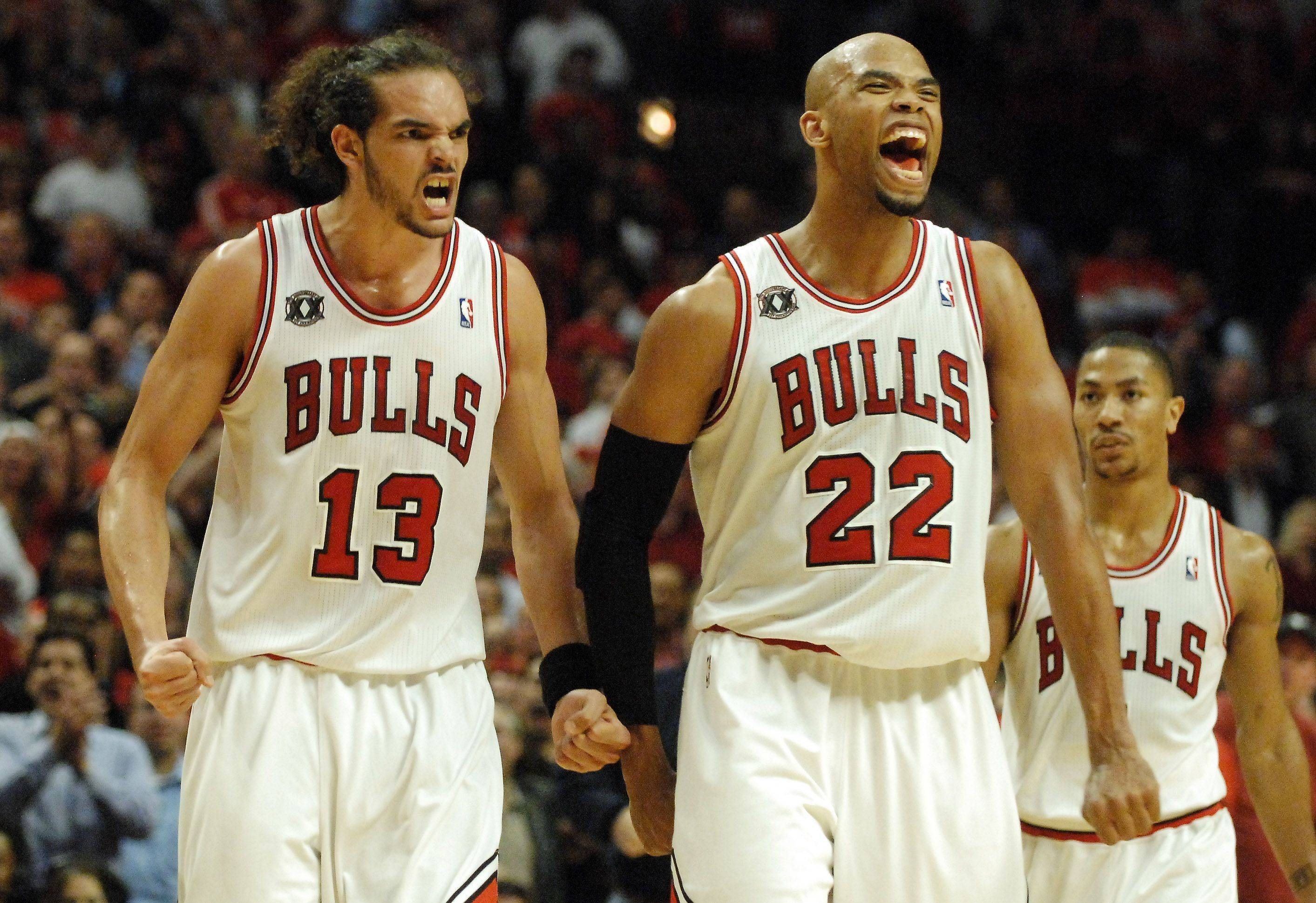 Chicago Bulls center Joakim Noah and forward Taj Gibson celebrate after a basket and Pacer foul in Chicago Tuesday.