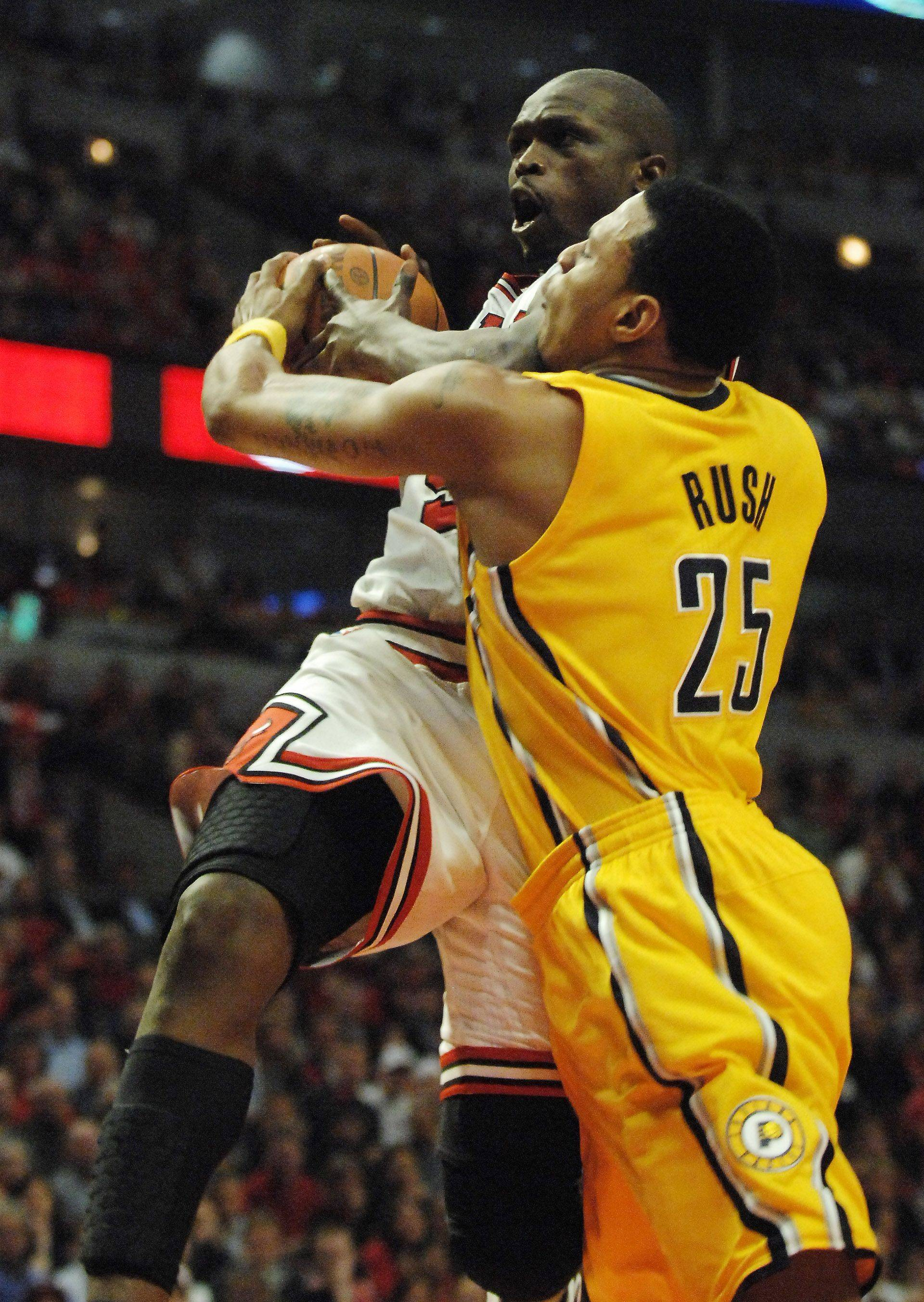 Bulls forward Luol Deng gets fouled by Pacers guard Brandon Rush during game 5.