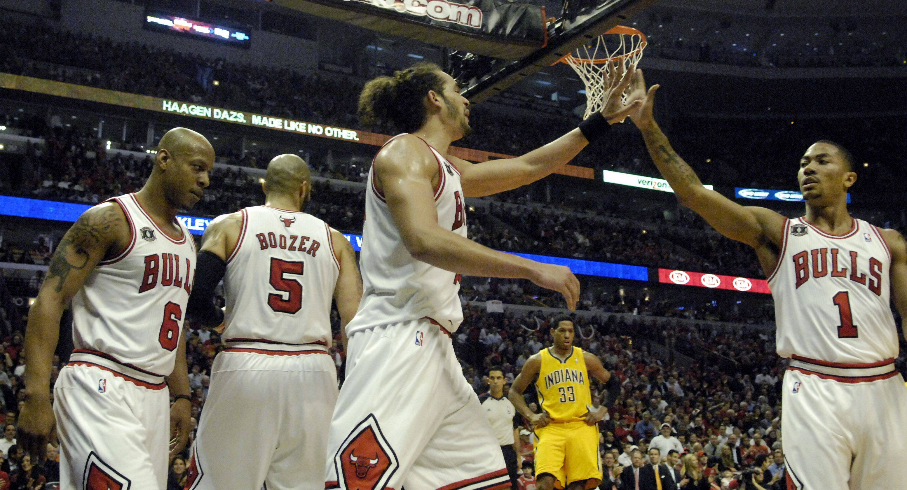 Bulls center Joakim Noah and point guard Derrick Rose high five after a Noah basket and foul in the first half against Indiana Tuesday.