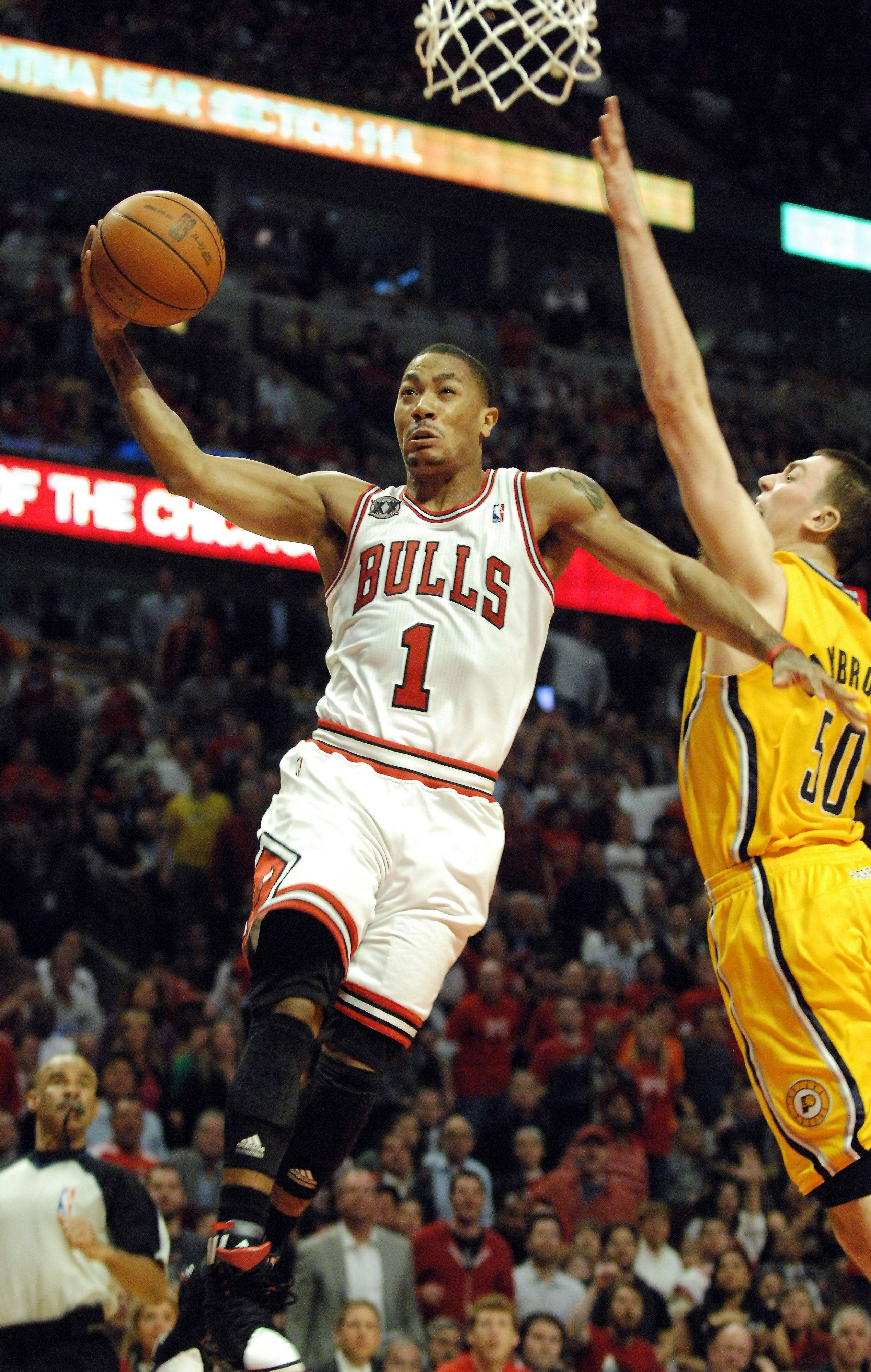 Derrick Rose drives to the basket past Indiana Pacers power forward Tyler Hansbrough in Chicago Tuesday.
