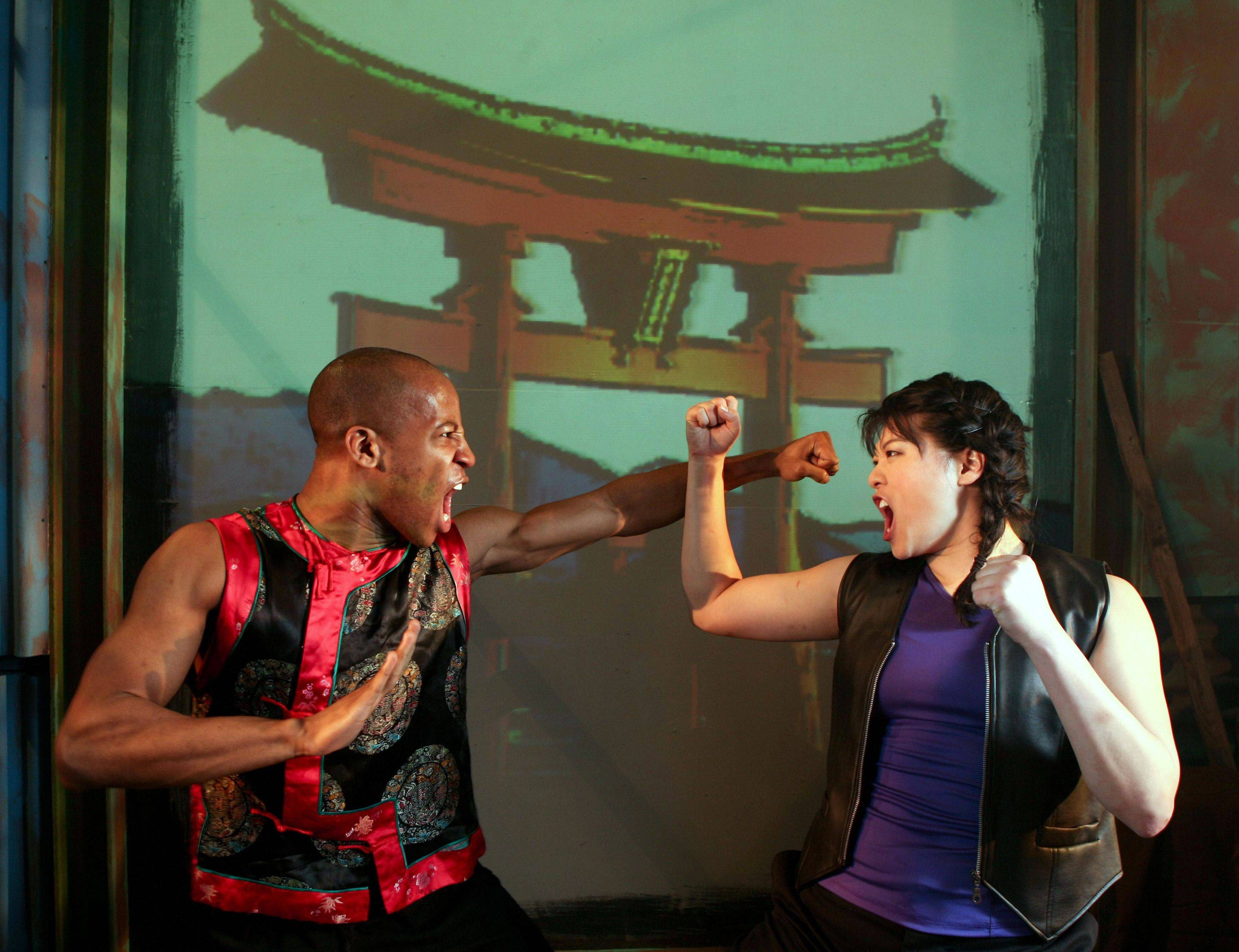 "Dewdrop (Christine Lin), right, trains with Master Leroy Green (Evan Lee) in InFusion Theatre Company's ""Soul Samurai"" at Theater Wit."