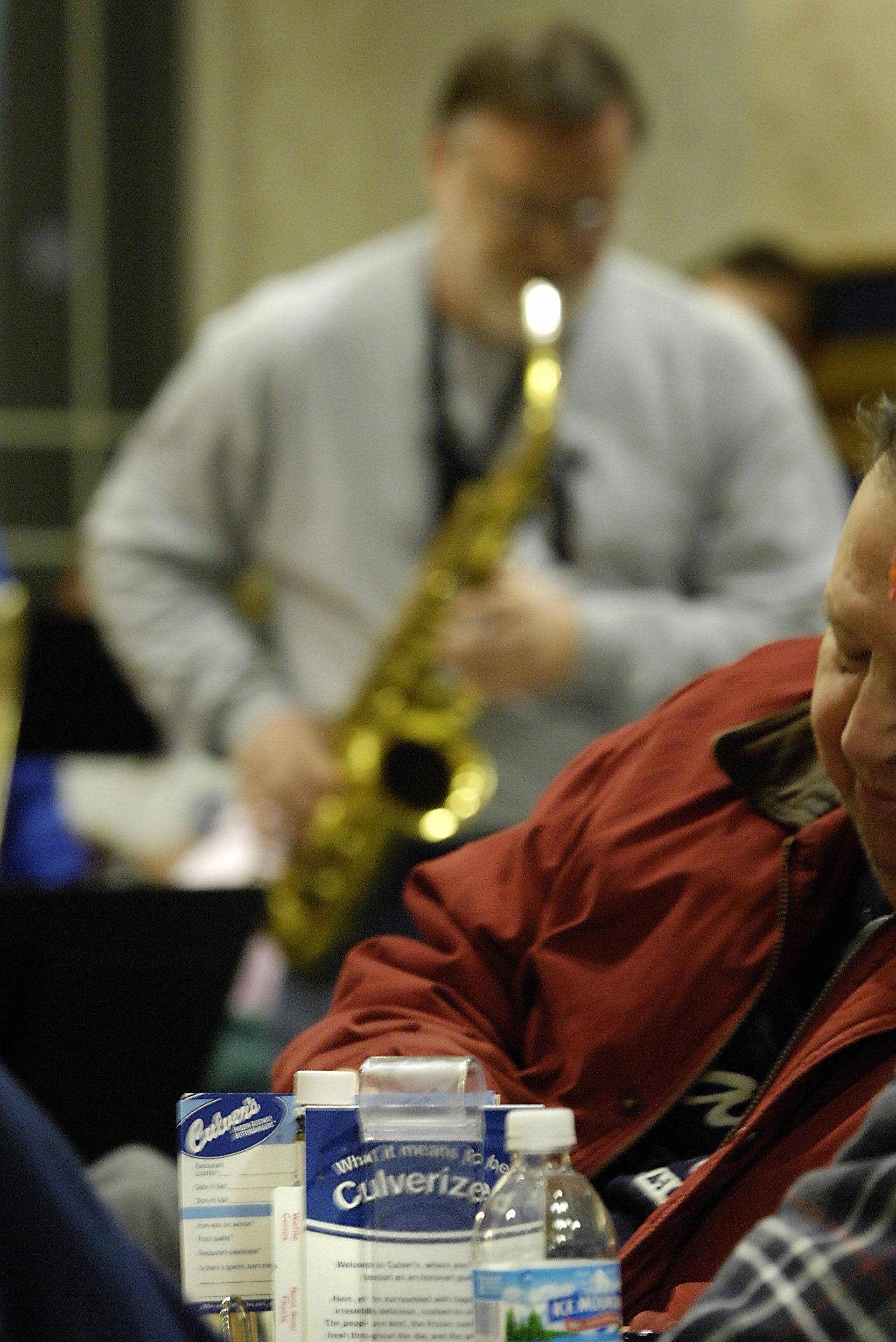 Middle schoolteacher Don Morrison plays a solo saxophone part as the District 158 Faculty Jazz Band performs at Culver's in Huntley last year. The band will return to Culver's on Tuesday, May 3, for Ravinia Fest 2011, an outdoor show -- or indoor, in case of rain -- to benefit the District 158 Education Foundation.