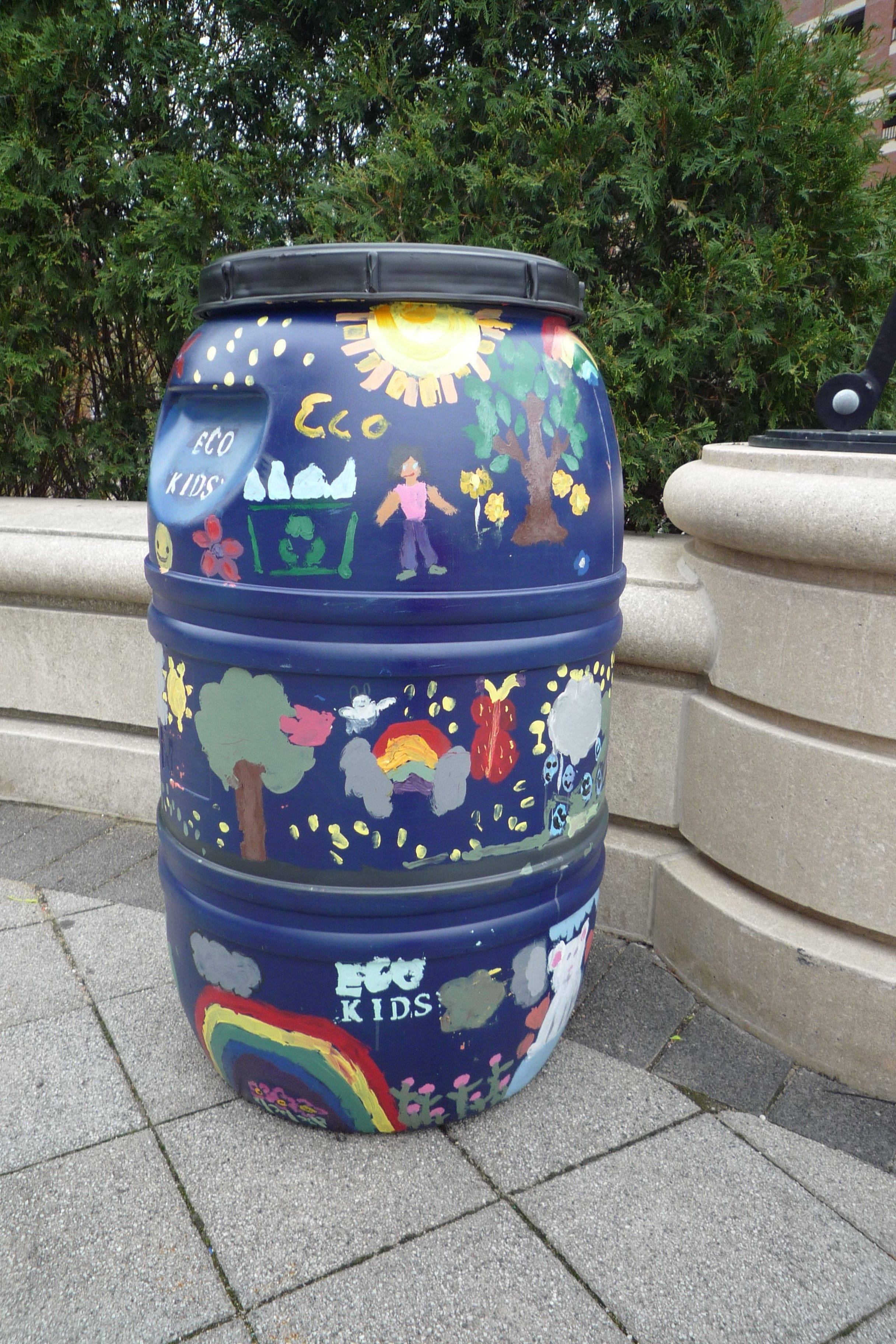 Students in Arlington Heights Elementary District 25 ecology clubs painted rain barrels that were displayed in Harmony Park in downtown Arlington Heights earlier this month.