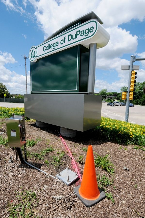 College of DuPage officials have argued that signs installed on campus aren't subject to village codes. Both sides have come close to a resolution, but a last-minute change by the village might put the agreement in jeopardy.