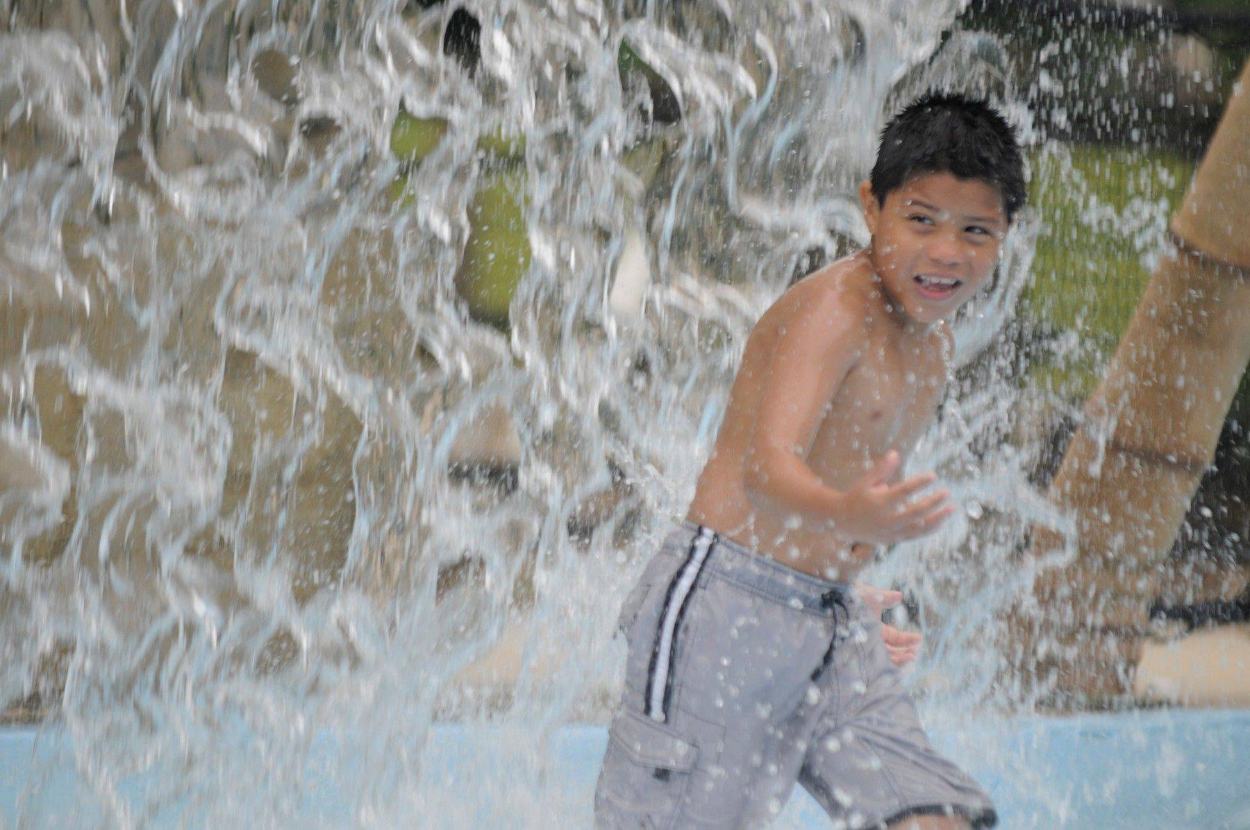 The cascading waterfall at Phillips Park Family Aquatic Center is a favorite for kids who want to be cool in the heat of summer.