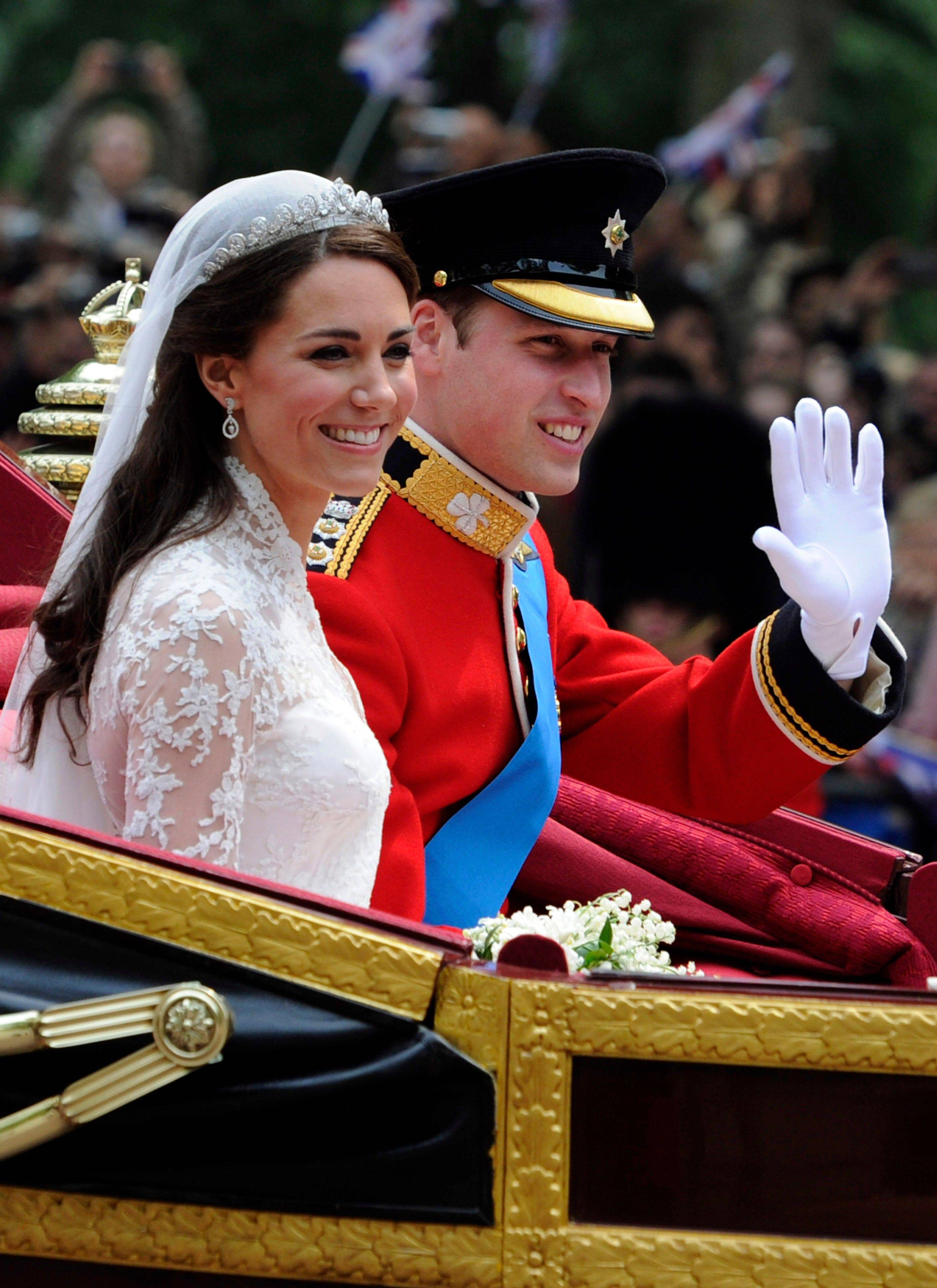 Britain's Prince William and his bride Kate, Duchess of Cambridge, leave Westminster Abbey, London, following their wedding, Friday April 29, 2011.