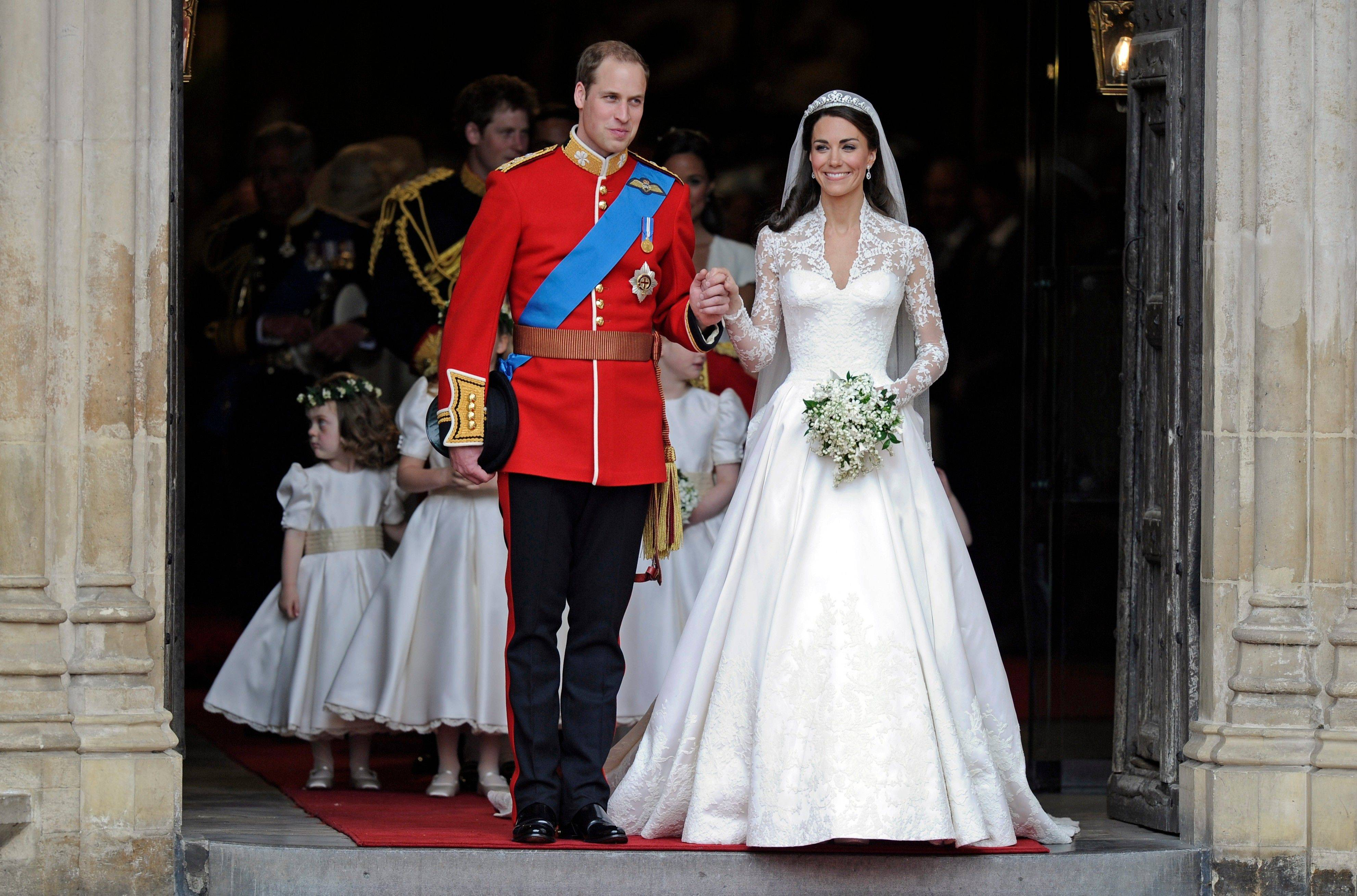 Britain's Prince William and his wife Kate, Duchess of Cambridge stand outside of Westminster Abbey after their Royal Wedding in London Friday, April, 29, 2011.