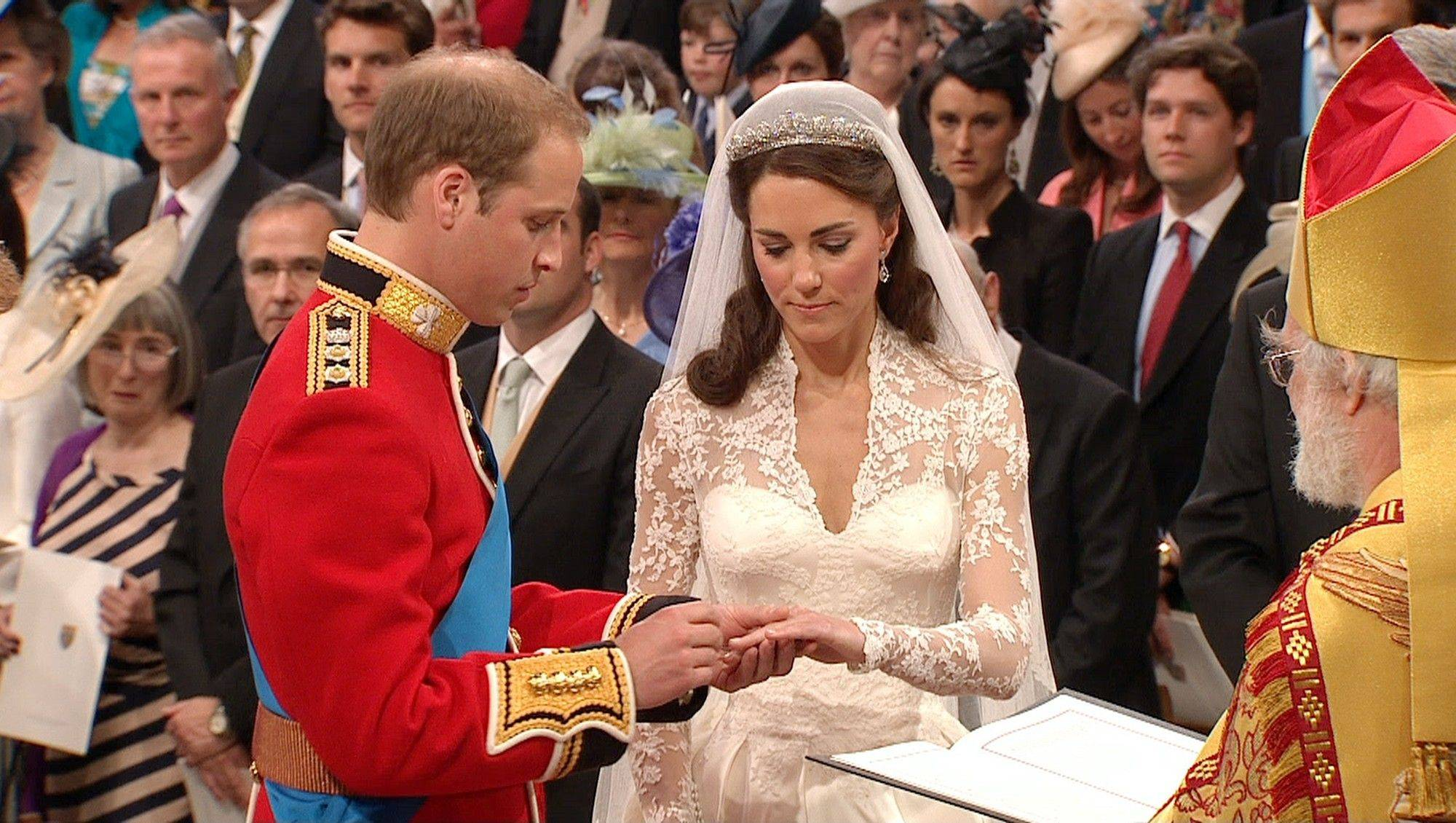 Britain's Prince William, left, places the ring on the finger of his bride, Kate Middleton, as they stand at the altar at Westminster Abbey for the Royal Wedding in London on Friday, April, 29, 2011.
