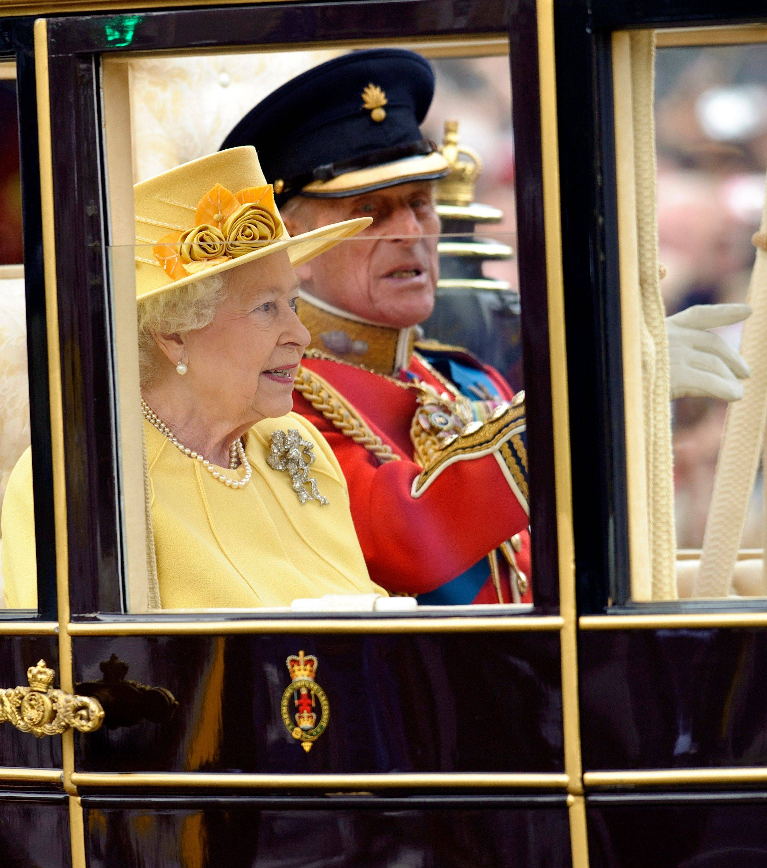 Britain's Queen Elizabeth II, left, and her husband Prince Philip, right, leave Westminster Abbey following the wedding of Britain's Prince William and his wife Kate, the Duchess of Cambridge, as they make their way along the procession route to Buckingham Palace, London, Friday, April, 29, 2011.