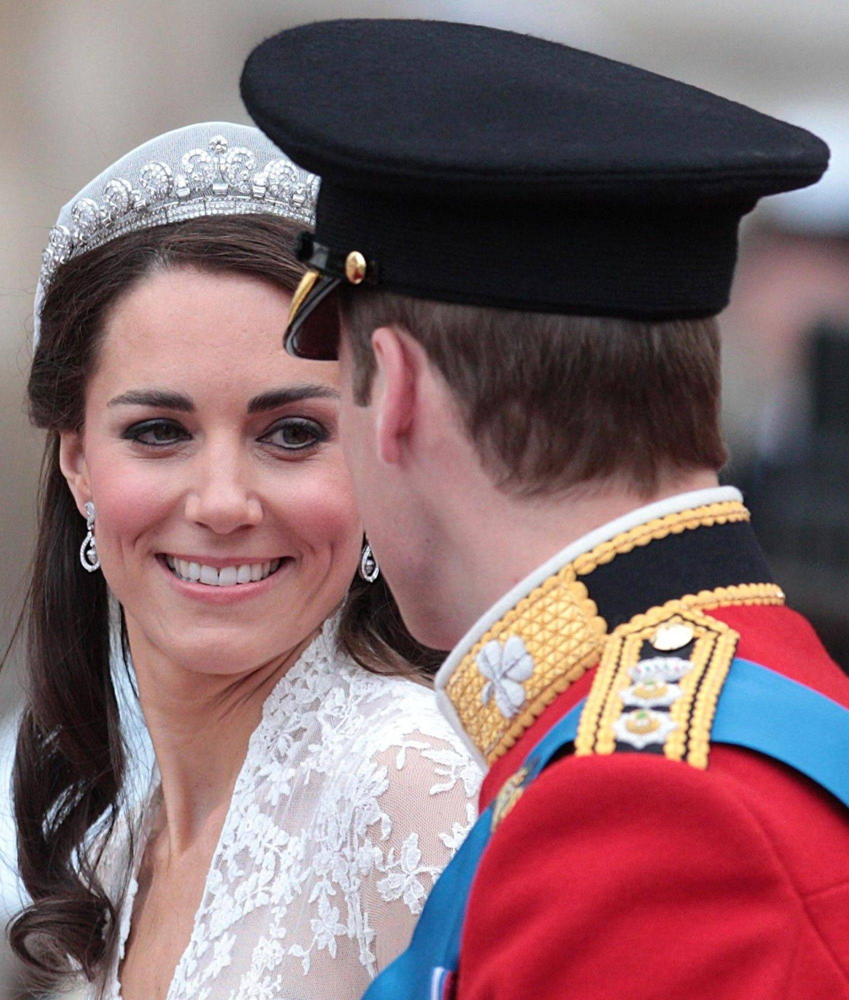 Kate, Duchess of Cambridge looks at her husband, Britain's Prince William, as they board the carriage following their wedding at London's Westminster Abbey, Friday Spril 29, 2011.