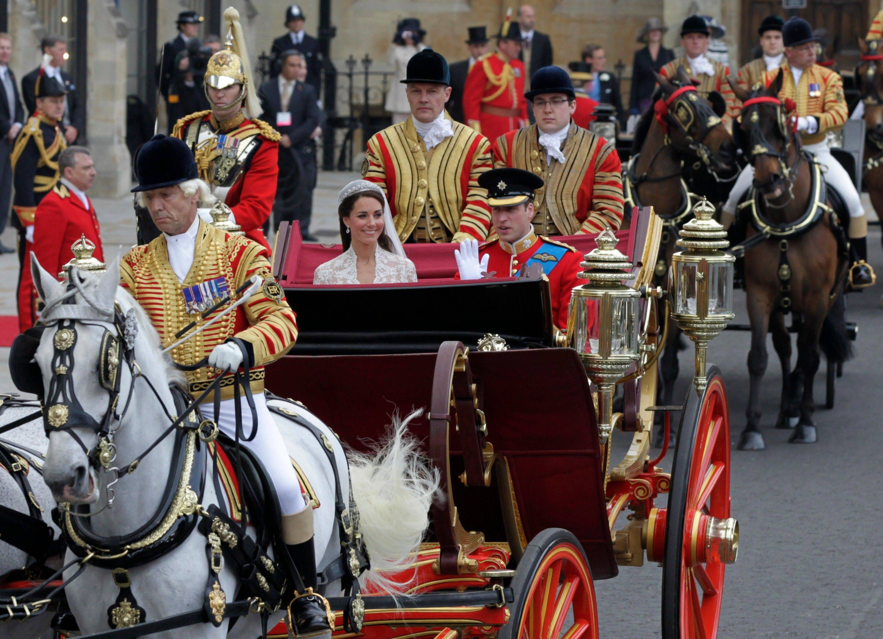 Britain's Prince William, right, and his wife Kate, Duchess of Cambridge, leave Westminster Abbey at the Royal Wedding in London Friday, April, 29, 2011.