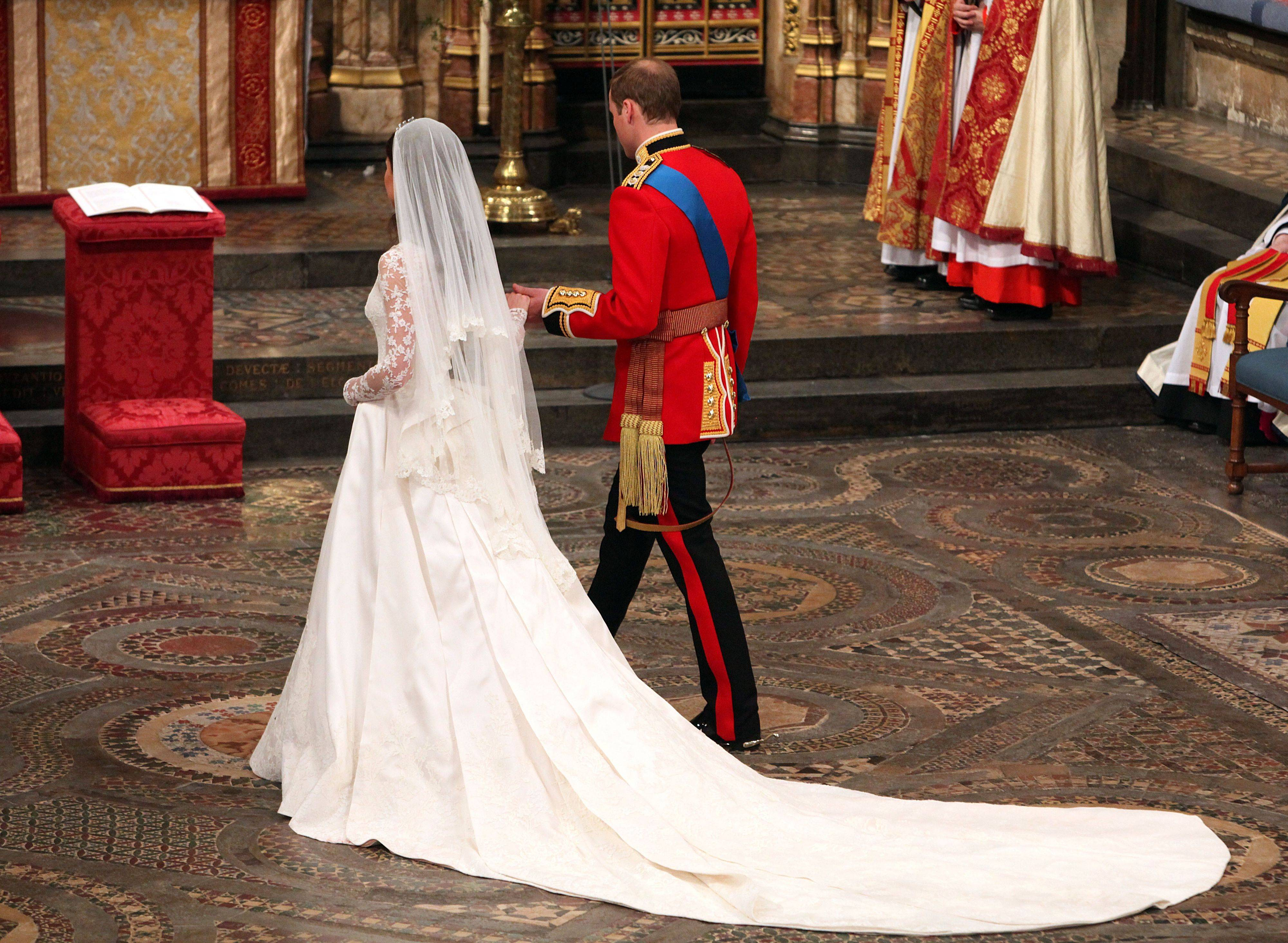 Kate, the Duchess of Cambridge, and Britain's Prince William walk hand in hand after their wedding service at Westminster Abbey, London, Friday April 29, 2011.