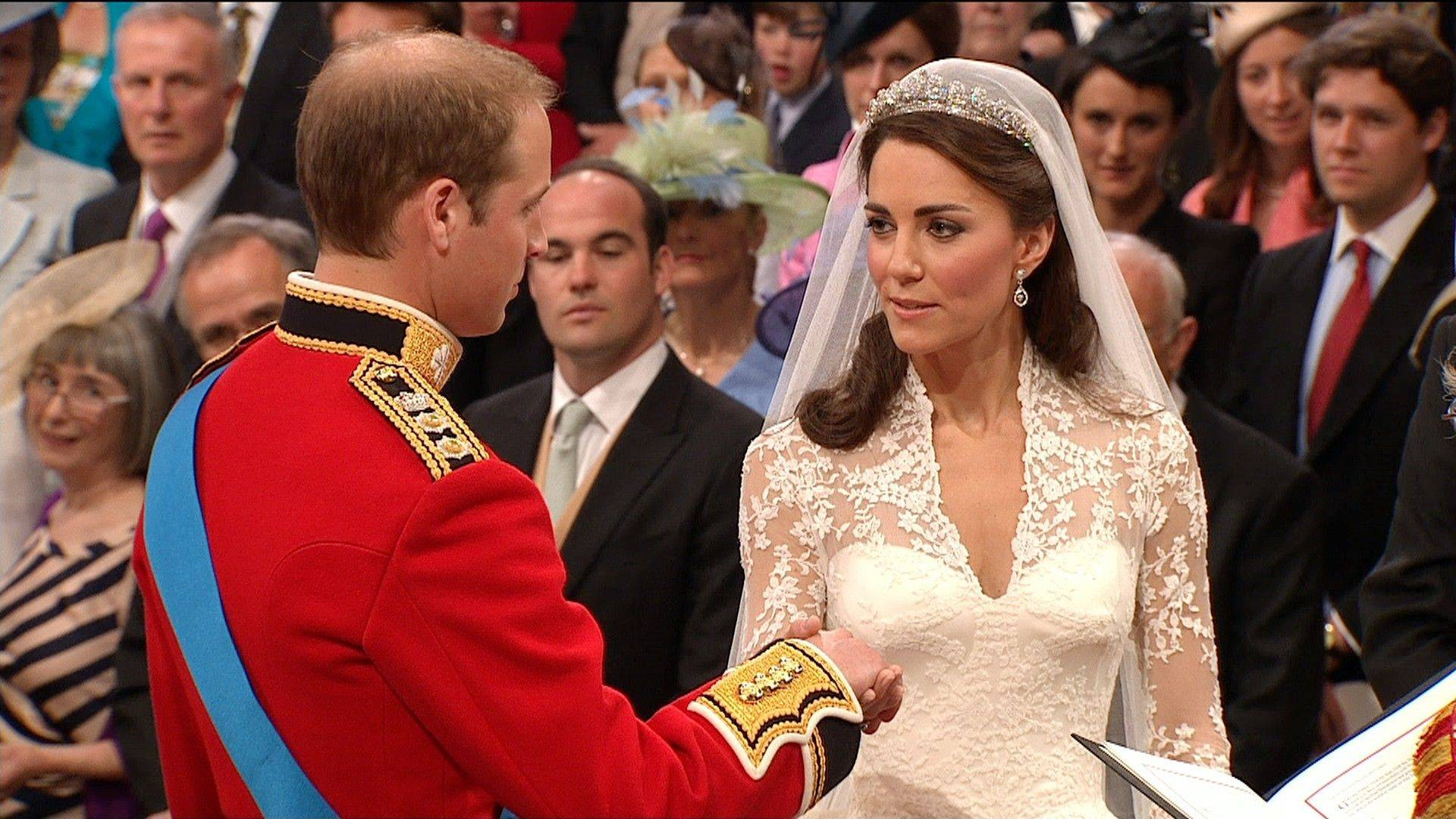 Britain's Prince William, left, takes the hand of his bride, Kate Middleton, as they stand at the altar at Westminster Abbey for the Royal Wedding in London on Friday, April, 29, 2011.