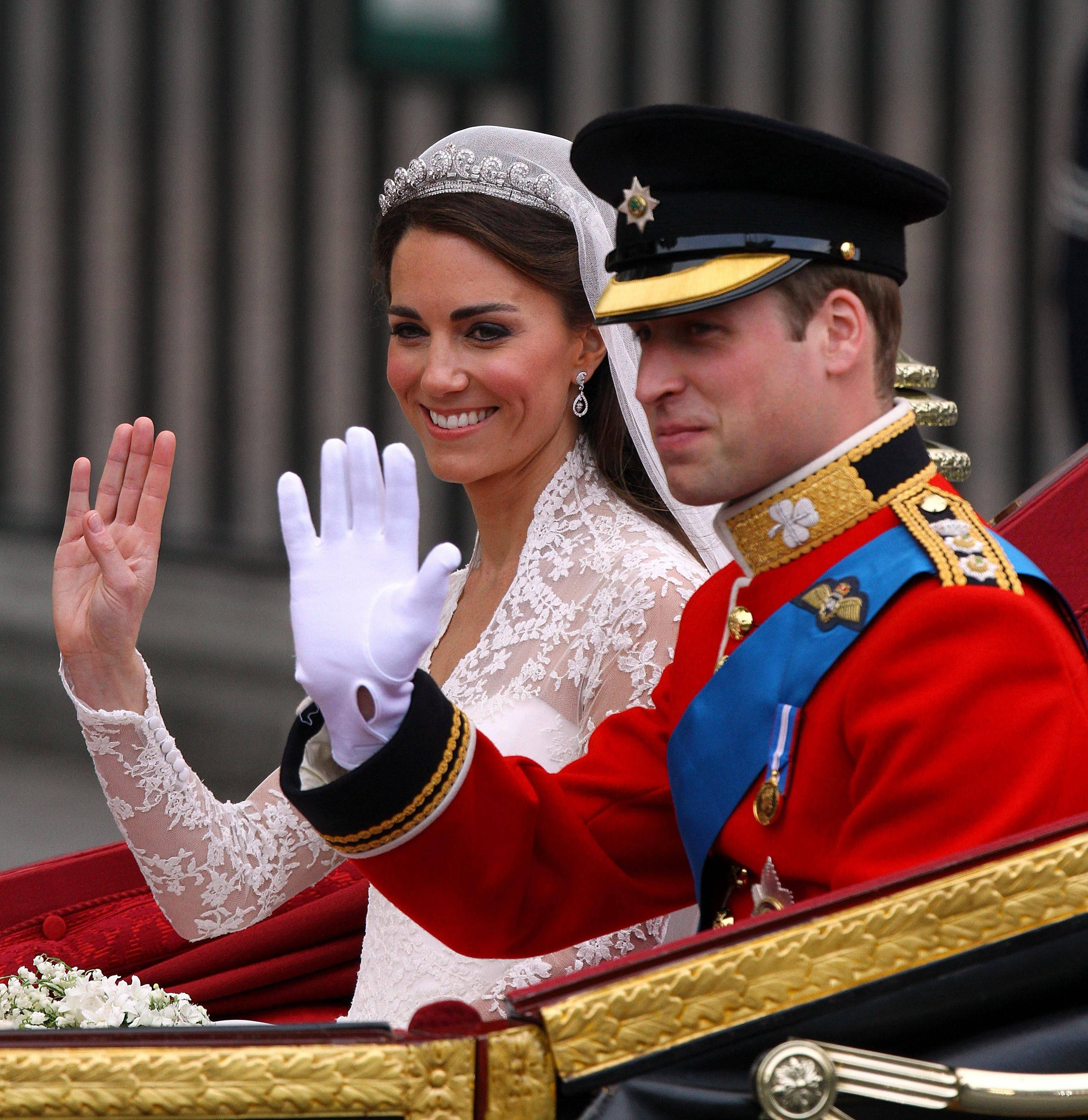 Prince William his bride Kate, Duchess of Cambridge, leave Westminster Abbey, London, following their wedding, Friday April. 29, 2011.