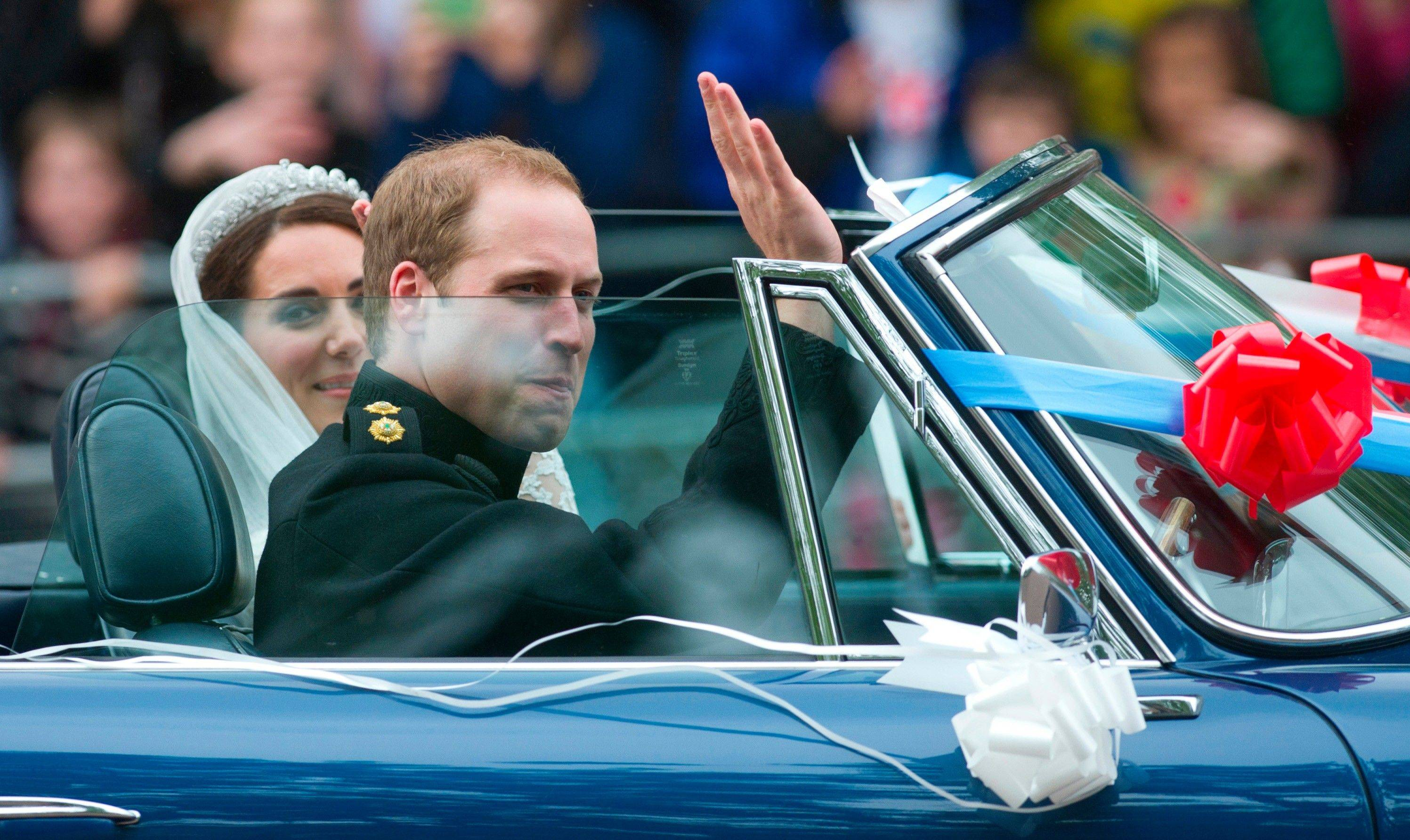 Britain's Prince William drives his wife Kate, Duchess of Cambridge, away from Buckingham Palace in a vintage Aston Martin Volante convertible after their wedding at London's Westminster Abbey, Friday, April, 29, 2011.