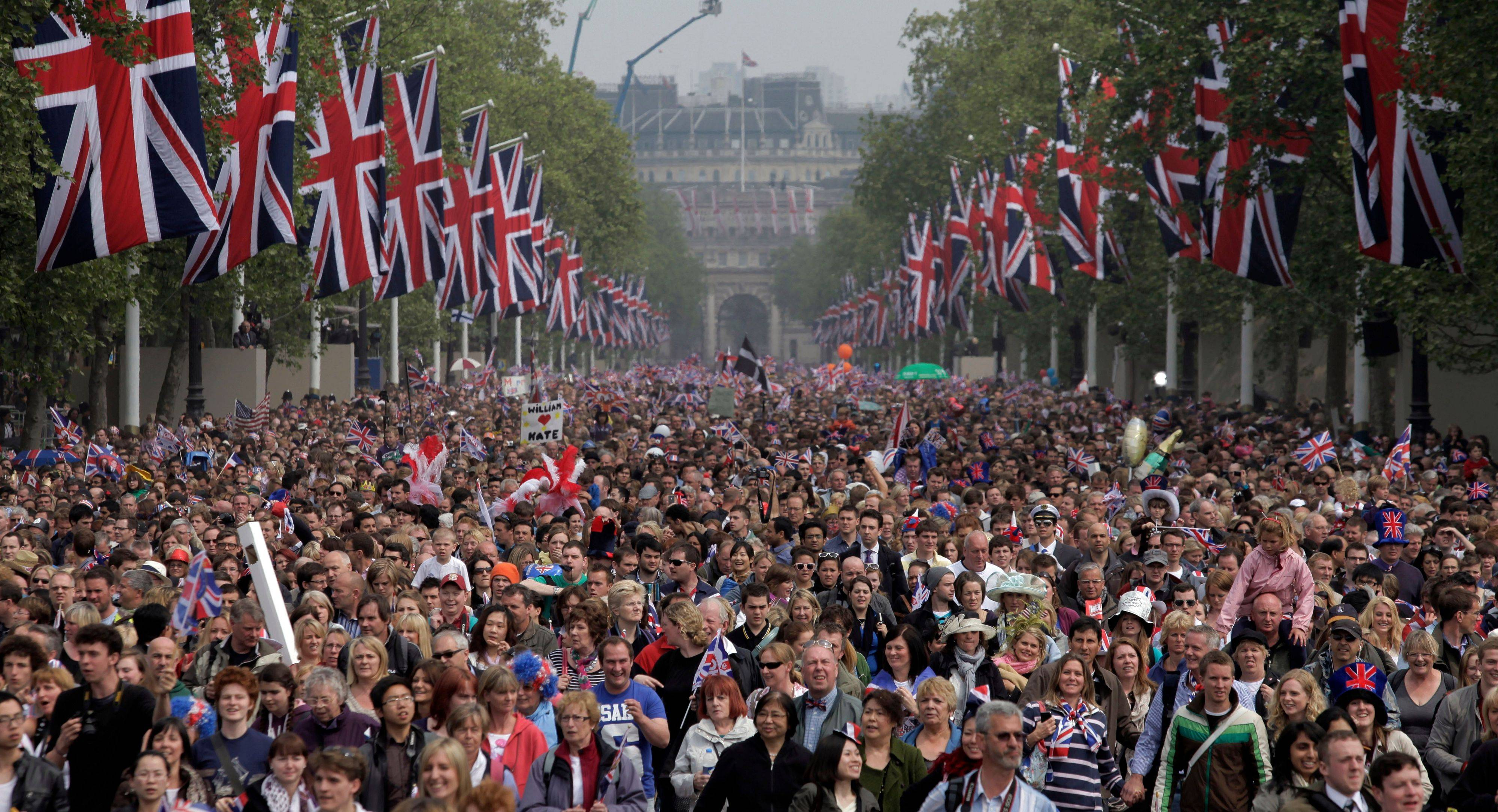 Spectators make their way down the Mall to Buckingham Palace after the Royal Wedding for Britain's Prince William and his wife Kate, Duchess of Cambridge in London Friday, April, 29, 2011.
