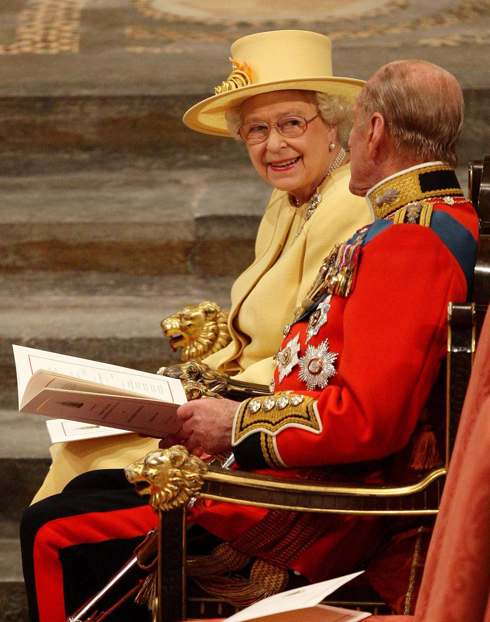 Britian's Queen Elizabeth II, her husband, the Duke of Edinburgh, take their seats at Westminster Abbey, central London before the wedding of the Queen's grandson, Prince William and Kate Middleton, Friday April 29, 2011.