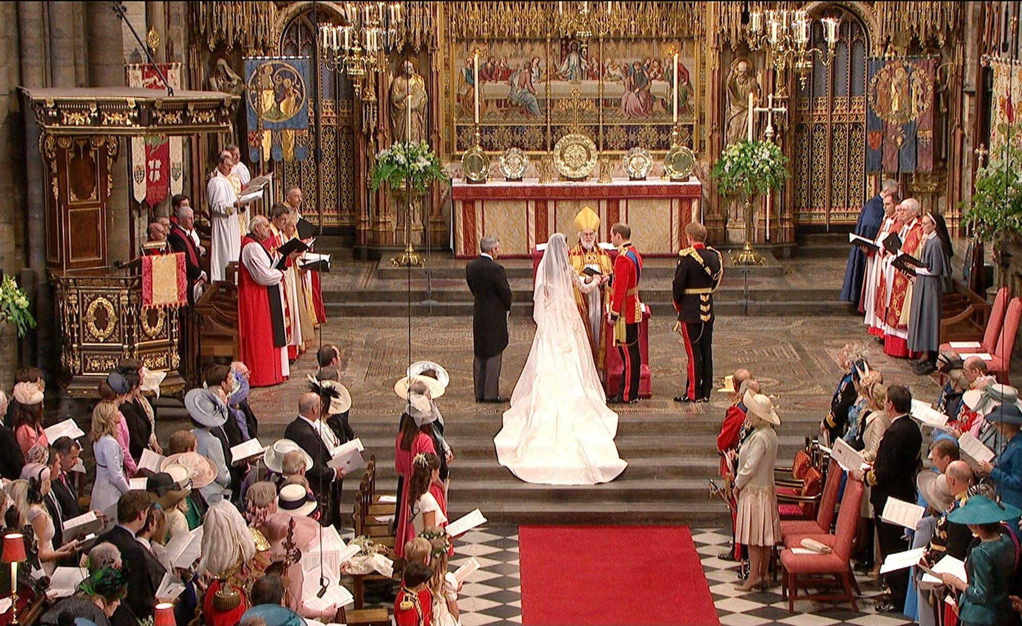 In this image taken from video, Britain's Prince William, left, takes the hand of his bride, Kate Middleton, as they stand at the altar at Westminster Abbey for the Royal Wedding in London on Friday, April, 29, 2011.