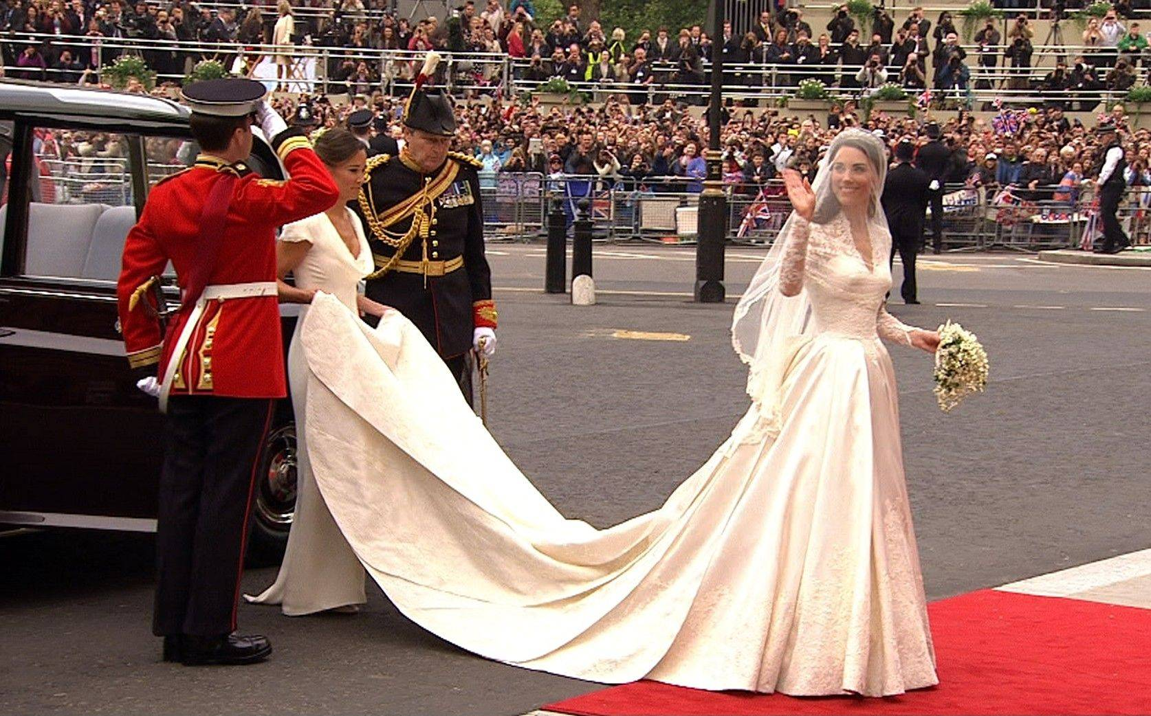 Kate Middleton waves as she arrives at Westminster Abbey for the Royal Wedding in London on Friday, April, 29, 2011.