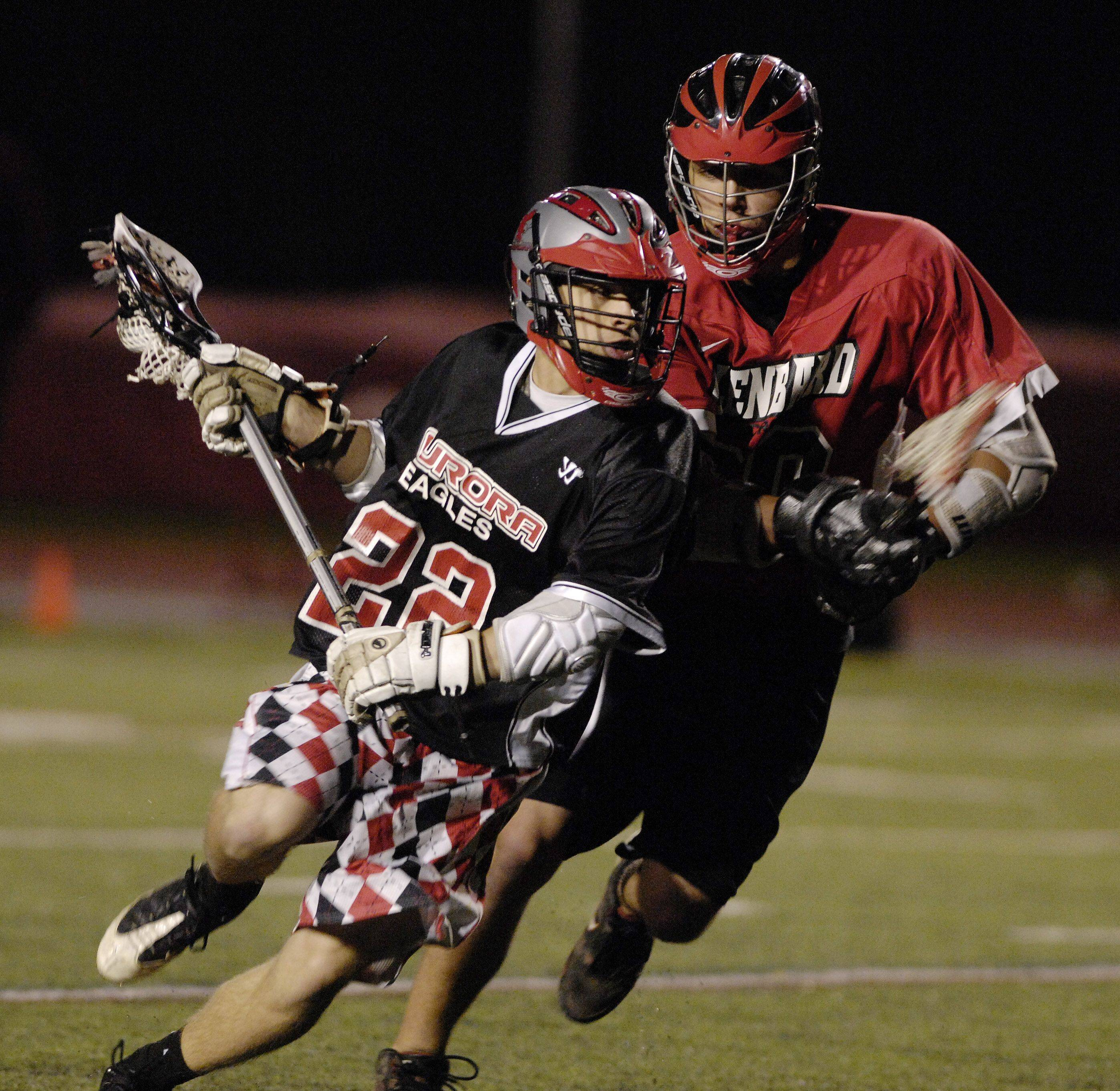Justin Sienicki of Aurora Christian drives the ball down field as Brian Sanborn of Glenbard pursues, during a lacrosse match at Benedictine University in Lisle on Wednesday April 17th, 2011.