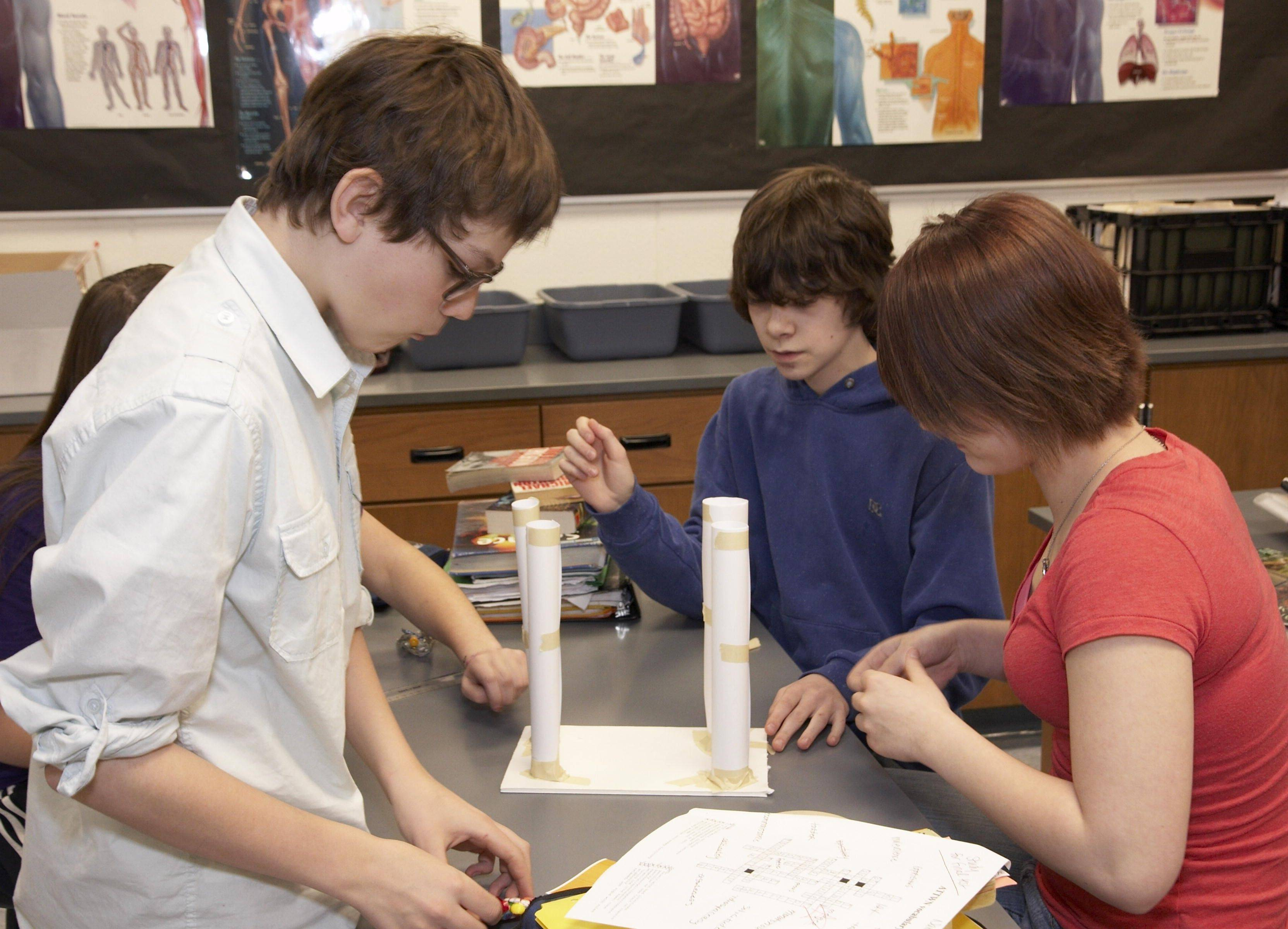 "Students at Fox River Grove Middle School put their mechanical and structural engineering skills to the test as they design and build a ""paper table"" during a Discover E visit from Northrop Grumman engineer Mark Trandel."