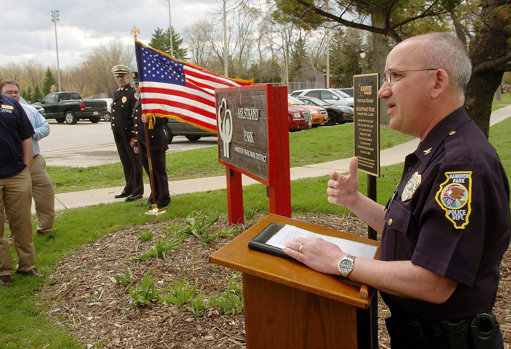 Deputy Police Chief Mark Getz says a few words Saturday during a ceremony to dedicate a marker at Ahlstrand Park commemorating the park's namesake, Carl Ahlstrand, former Hanover Park Police Chief who was killed in the line of duty in 1959.