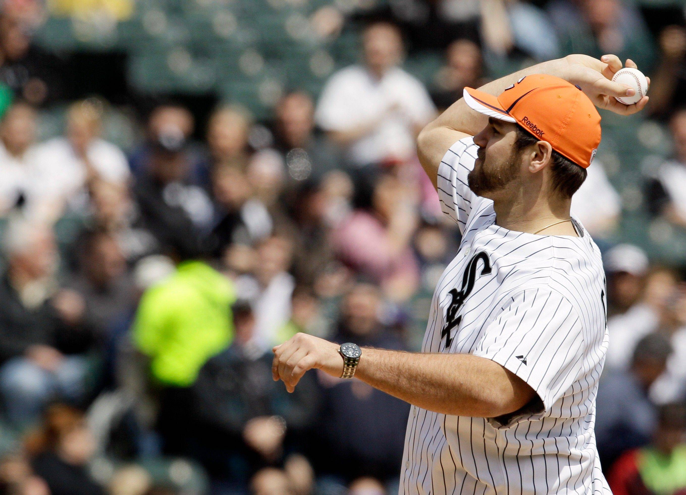 Bears first-round draft pick Gabe Carimi throws a first pitch before Sunday's White Sox game.